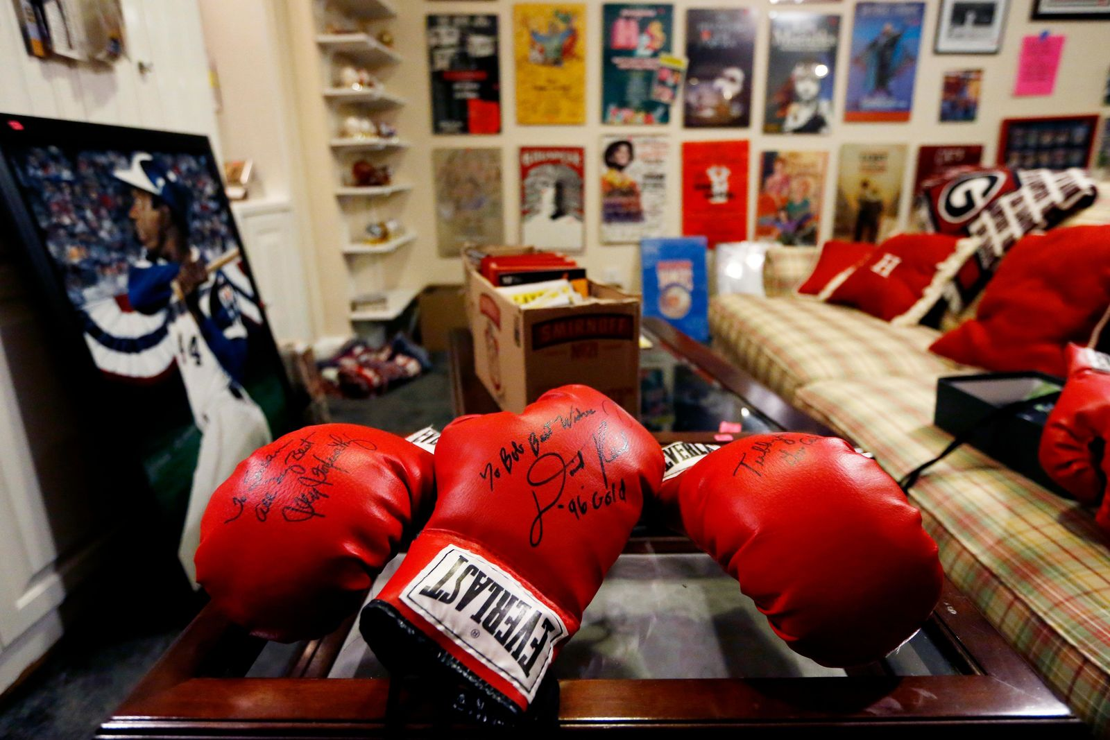 Autographed boxing gloves are seen in Bob Hope's basement, which holds his sports memorabilia collection for sale, Friday, Aug. 23, 2019, in Stone Mountain, Ga.{ } (AP Photo/Andrea Smith)