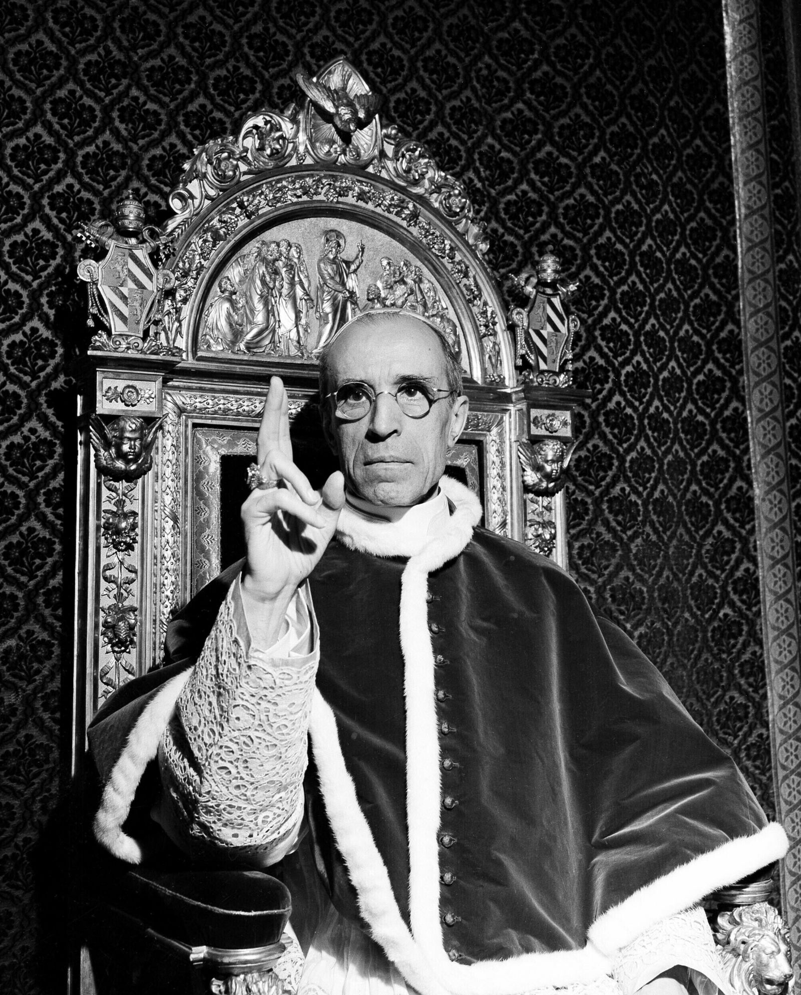 FILE - In this file photo dated Sept. 1945, Pope Pius XII, wearing the ring of St. Peter, raises his right hand in a papal blessing at the Vatican. The Vatican's chief librarian and archivists said Thursday, Feb. 20, 2020 that all researchers _ regardless of nationality, faith and ideology _ were welcome to request access to the soon-to-open Vatican's apostolic library on Pope Pius XII starting March 2.  (AP Photo, File)