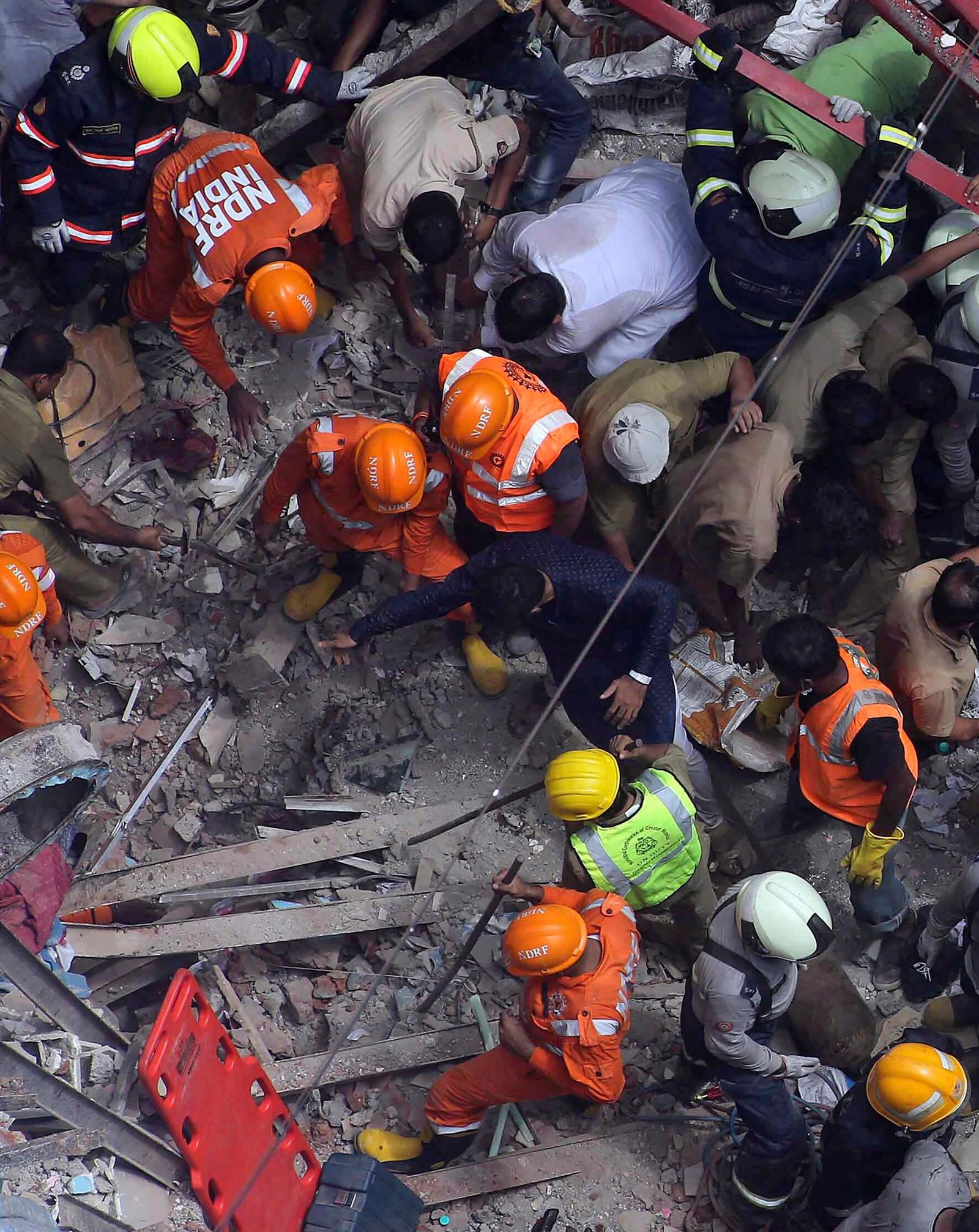 Rescuers work at the site of a building that collapsed in Mumbai, India, Tuesday, July 16, 2019. nt capital, and several people were feared trapped in the rubble, an official said. (AP Photo/Rajanish Kakade)