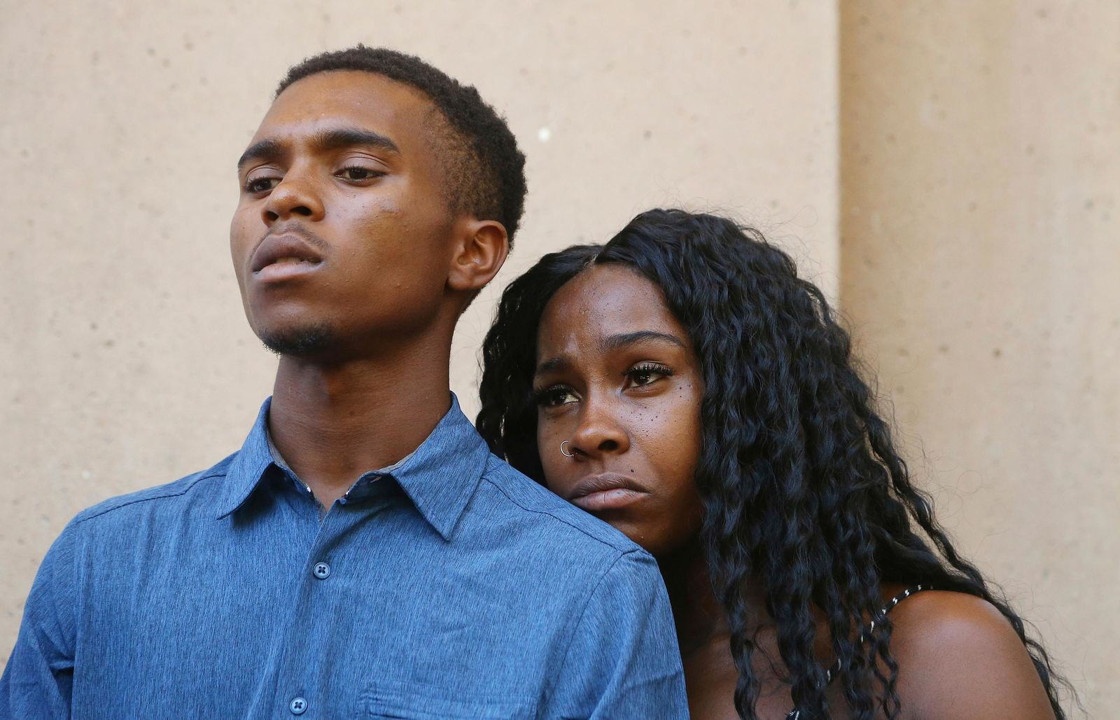 Dravon Ames, left, and Iesha Harper pause as they listen to a question during a news conference at Phoenix City Hall, Monday, June 17, 2019, in Phoenix. (AP Photo/Ross D. Franklin)