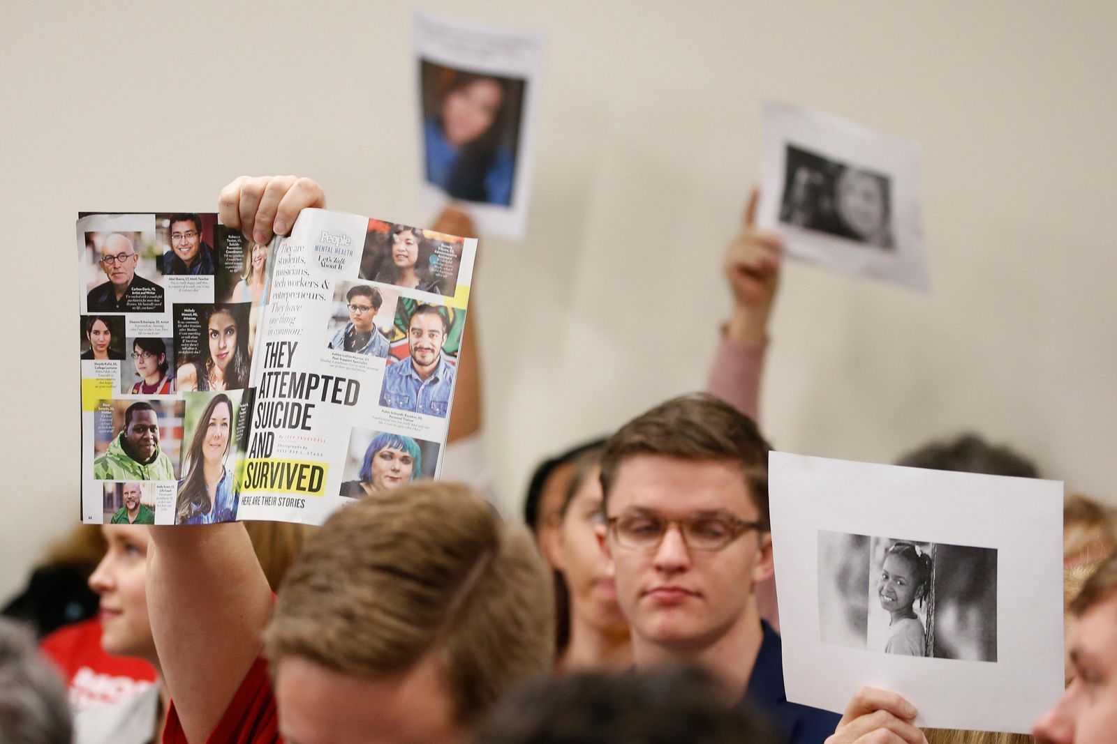 FILE - In a Monday, Jan. 13, 2020 file photo, supporters of gun laws hold us photos of gun violence victims during a meeting of the Senate Judiciary committee at the Capitol in Richmond, Va. Gun-rights groups asked a judge Thursday, Jan. 16, 2020 to block Virginia Gov. Ralph Northam from banning guns on Capitol grounds during a massive pro-gun rally scheduled for Monday, Jan. 20, 2020. (AP Photo/Steve Helber, File)