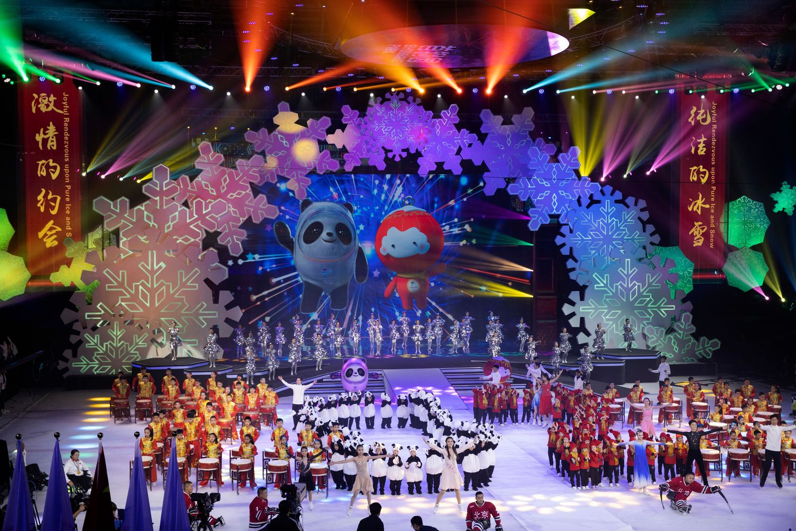 Beijing 2022 Winter Olympic Mascot Bing Dwen Dwen, left on screen and 2022 Winter Paralympic Games mascot Shuey Rong Rong, right on screen are revealed during a ceremony held at the Shougang Ice Hockey Arena in Beijing on Tuesday, Sept. 17, 2019. (AP Photo/Ng Han Guan)