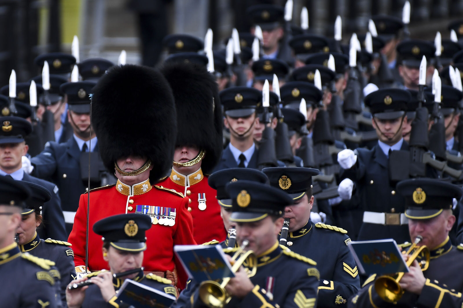 Members of the Armed Forces march on The Mall ahead of the State Opening of Parliament ceremony in London, Monday, Oct. 14, 2019. (AP Photo/Alberto Pezzali)