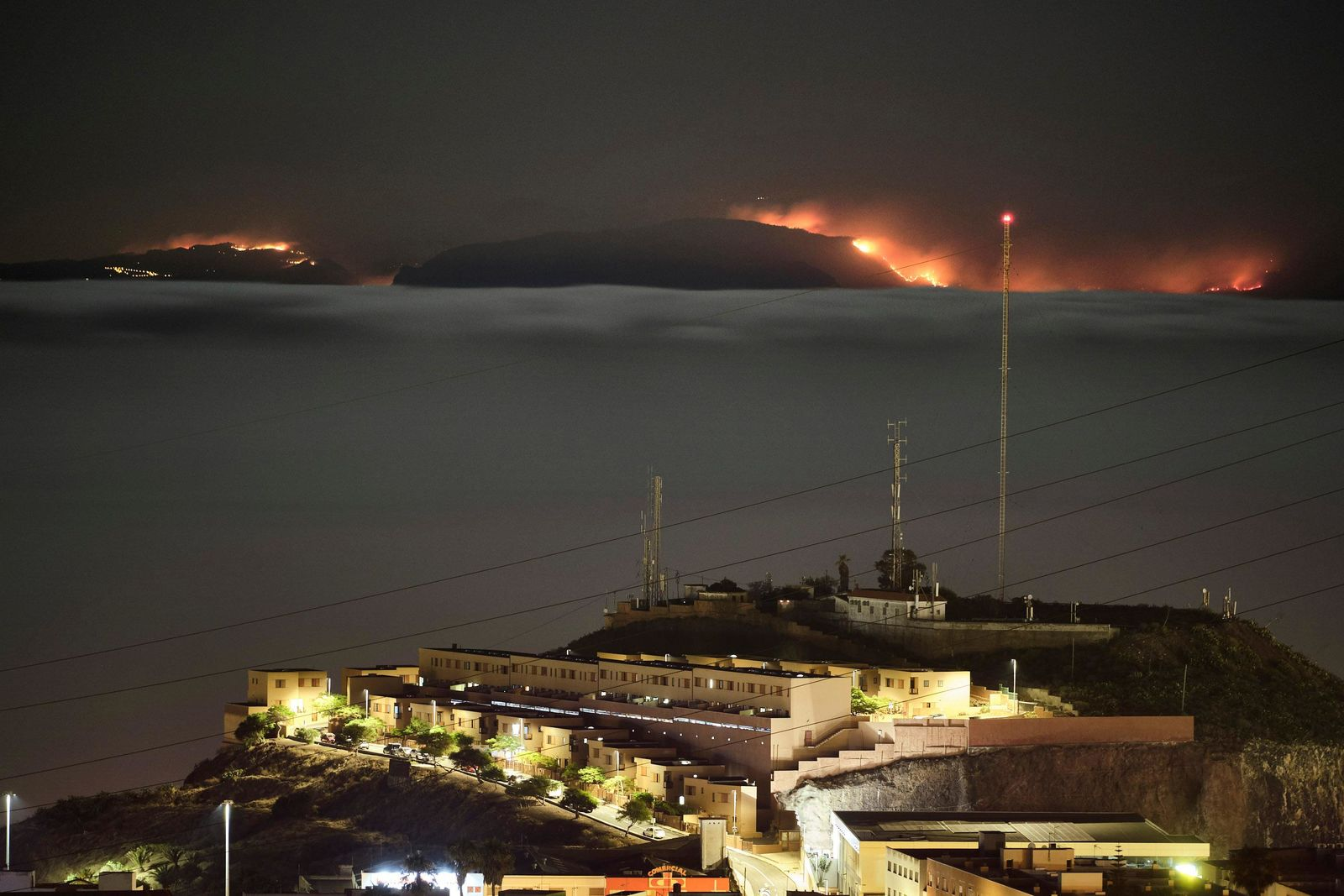 The fire on the mountains of the Canary Islands in this view taken from Santa Cruz de Tenerife island, Spain, early Monday, Aug. 19, 2019.{ } (AP Photo/Andres Gutierrez)