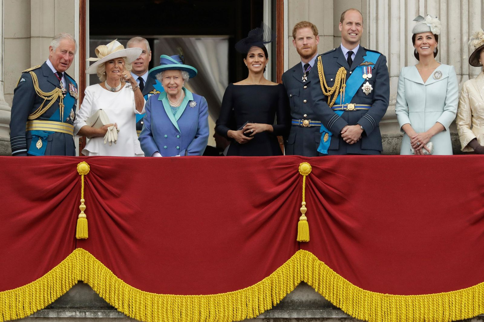 FILE - In this Tuesday, July 10, 2018 file photo, members of the royal family gather on the balcony of Buckingham Palace, with from left, Prince Charles, Camilla the Duchess of Cornwall, Prince Andrew, Queen Elizabeth II, Meghan the Duchess of Sussex, Prince Harry, Prince William and Kate the Duchess of Cambridge, as they watch a flypast of Royal Air Force aircraft pass over Buckingham Palace in London. In a statement issued on Monday, Jan. 13, 2020, Queen Elizabeth II says she has agreed to grant Prince Harry and Meghan their wish for a more independent life that will see them move part-time to Canada. (AP Photo/Matt Dunham, File)