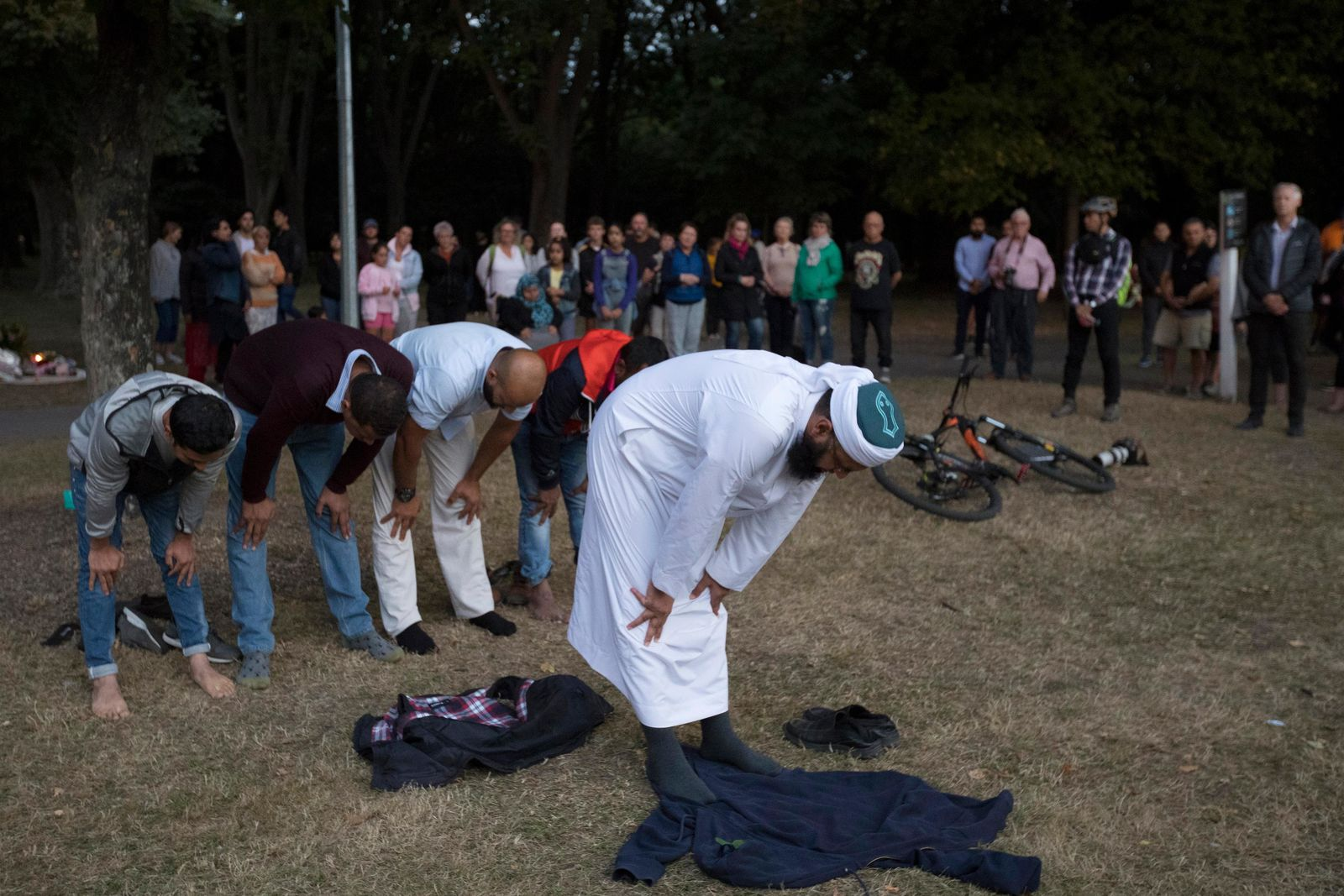 Muslims offer prayer near the main road to the Al Noor mosque in Christchurch, New Zealand, Tuesday, March 19, 2019.{ } (AP Photo/Vincent Thian)