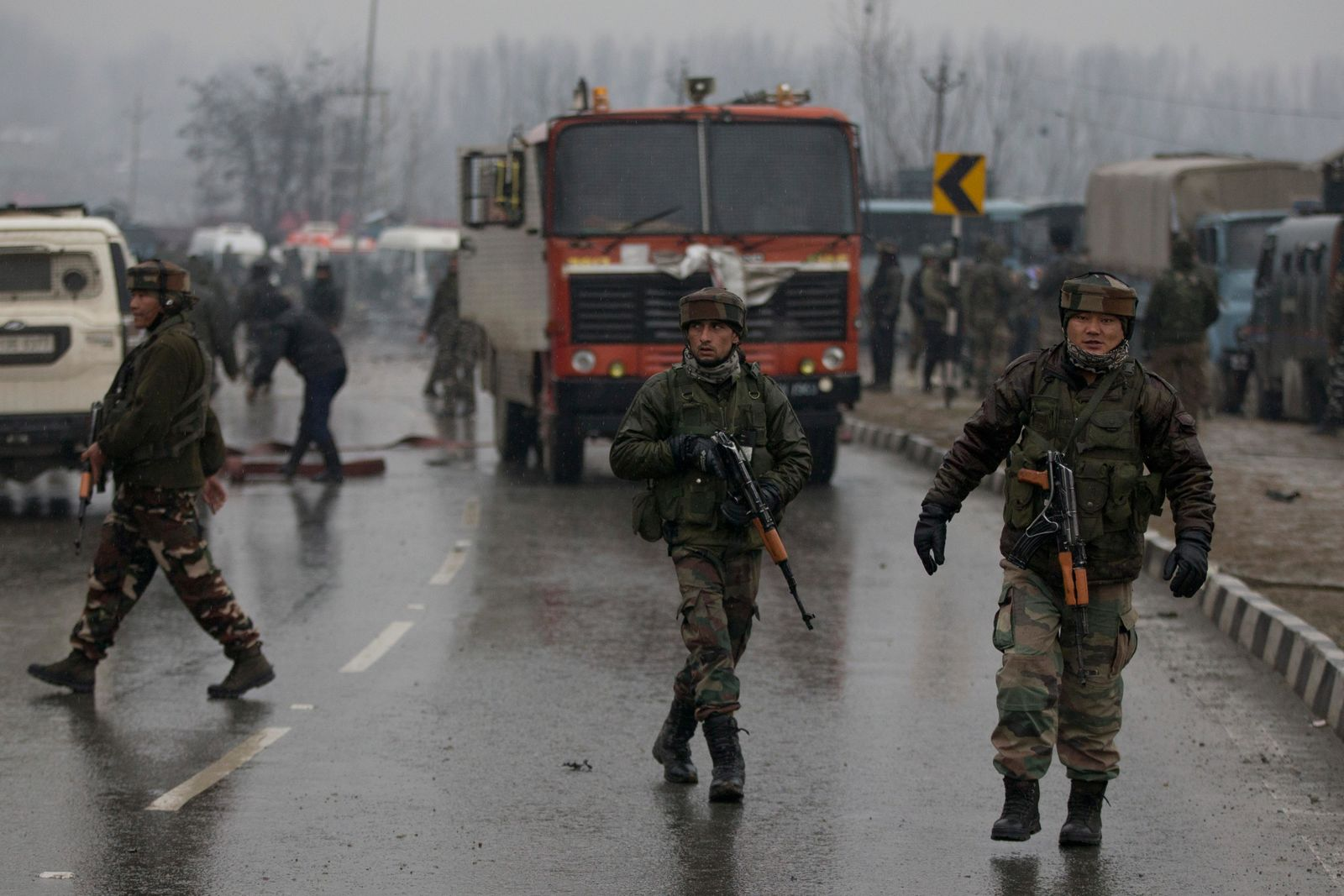 Indian paramilitary soldiers patrol near the site of an explosion in Pampore, Indian-controlled Kashmir, Thursday, Feb. 14, 2019. . (AP Photo/Dar Yasin)