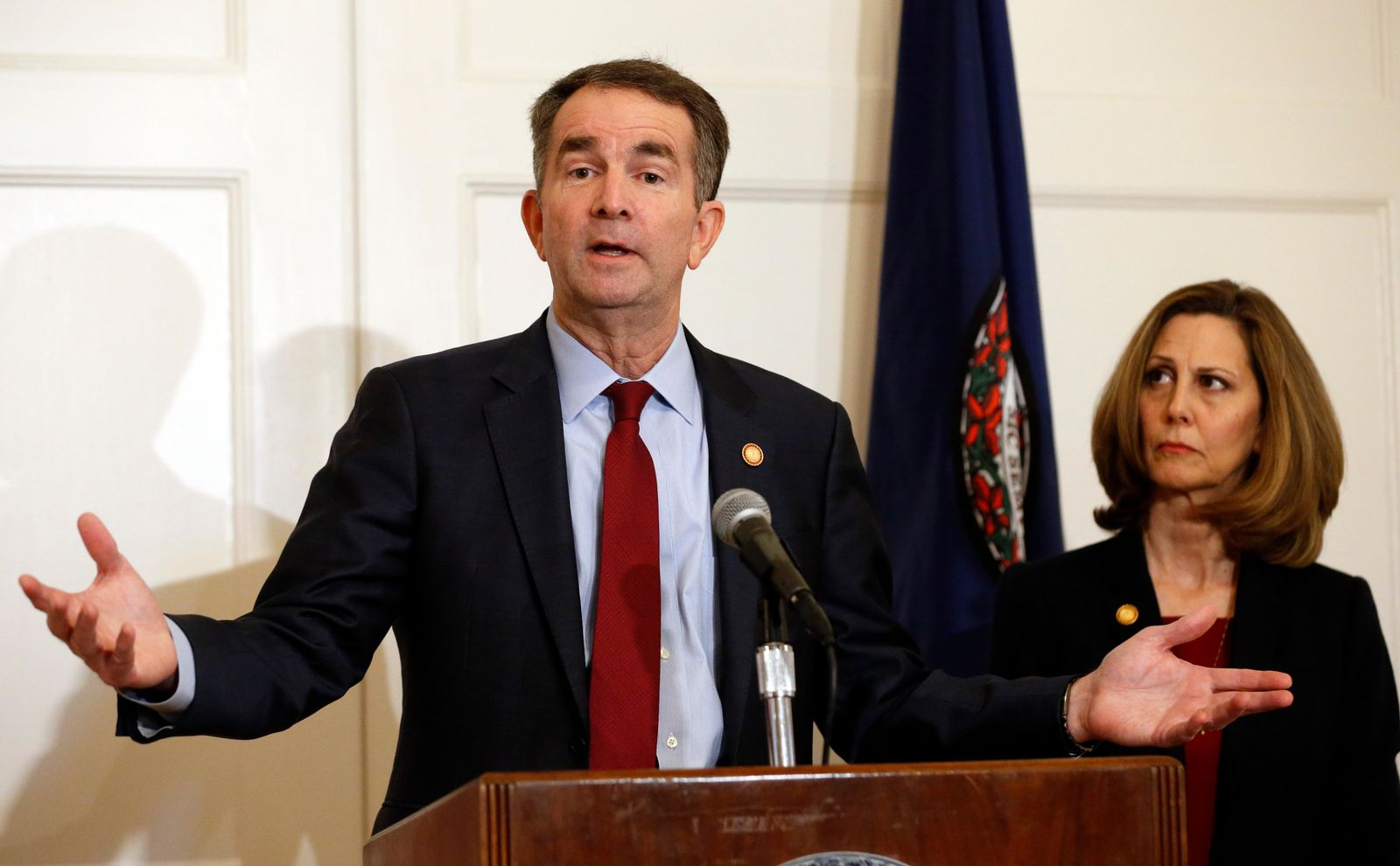 In this Feb. 2, 2019, photo, Virginia Gov. Ralph Northam, left, accompanied by his wife, Pam, speaks during a news conference in the governor's mansion in Richmond, Va. (AP Photo/Steve Helber)