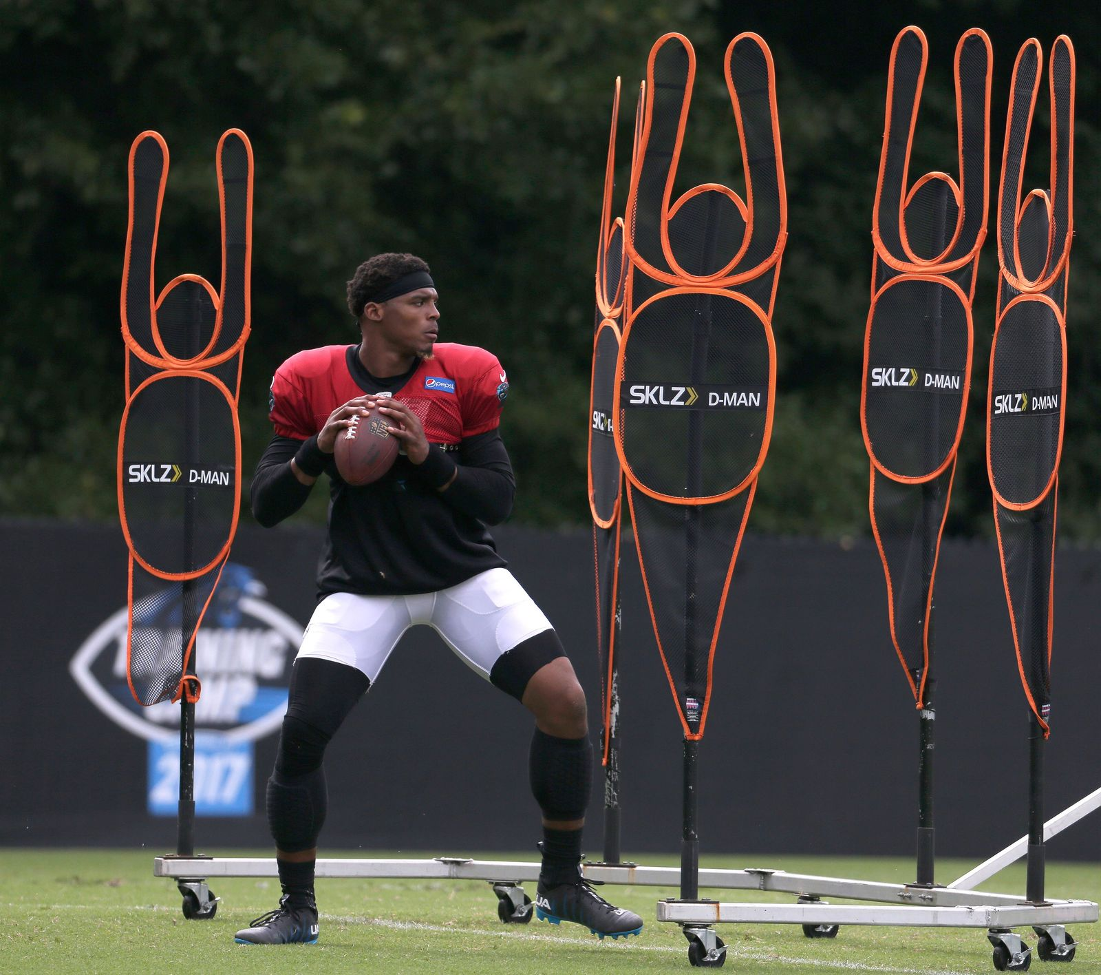 Carolina Panthers' Cam Newton (1) runs a drill during practice at the NFL team's football training camp at Wofford College in Spartanburg, S.C., Wednesday, Aug. 2, 2017. (AP Photo/Chuck Burton)