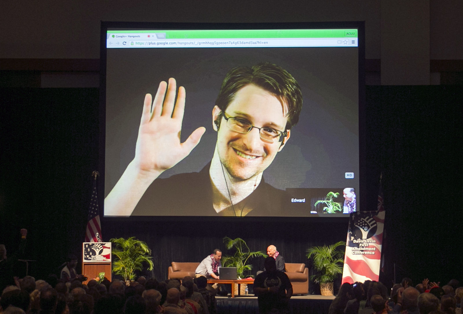 FILE - In this Feb. 14, 2015, file photo, Edward Snowden appears on a live video feed broadcast from Moscow at an event sponsored by ACLU Hawaii in Honolulu.{ } (AP Photo/Marco Garcia, File)
