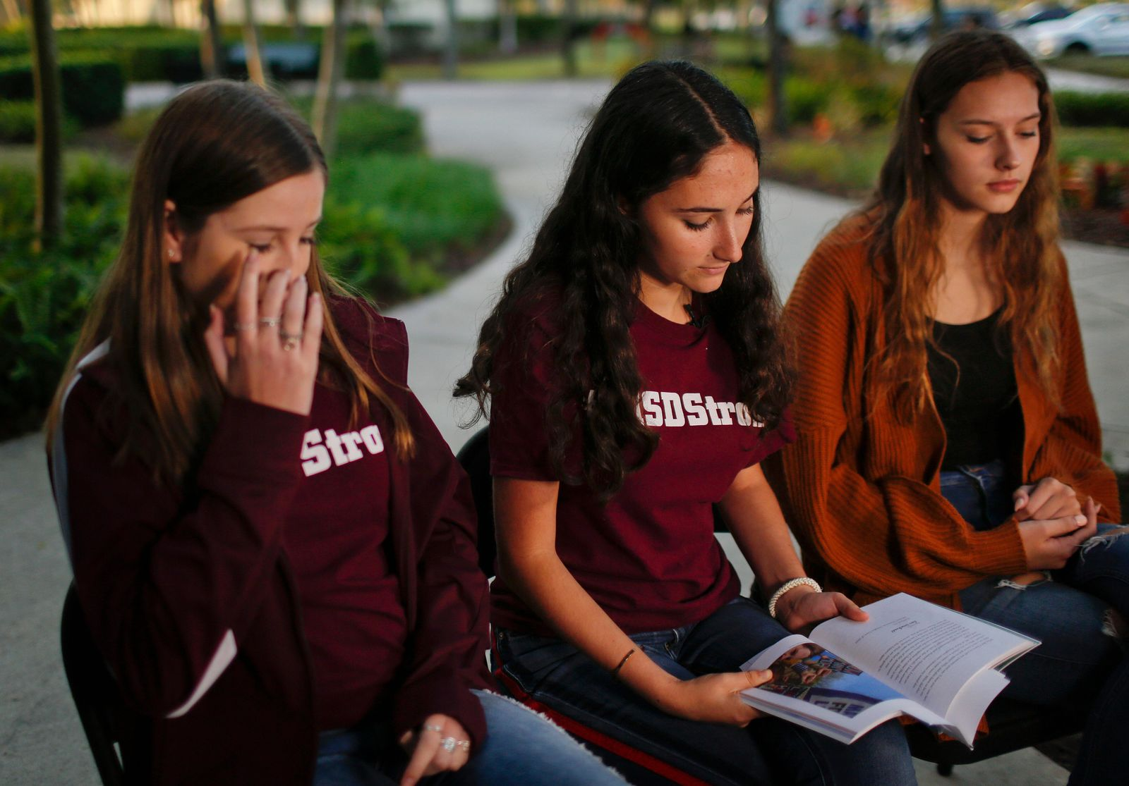 "In this Wednesday, Jan. 16, 2019, photo, Brianna Fisher, 16, left, Leni Steinhardt, 16, center, and Brianna Jesionowski sit during an interview with The Associated Press about a new book called ""Parkland Speaks. (AP Photo/Brynn Anderson)"