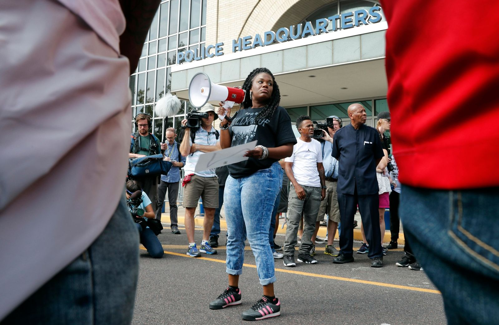 FILE - In this Sept. 17, 2017 file photo, Cori Bush speaks on a bullhorn to protesters outside the St. Louis Police Department headquarters in St. Louis. (AP Photo/Jeff Roberson, File)