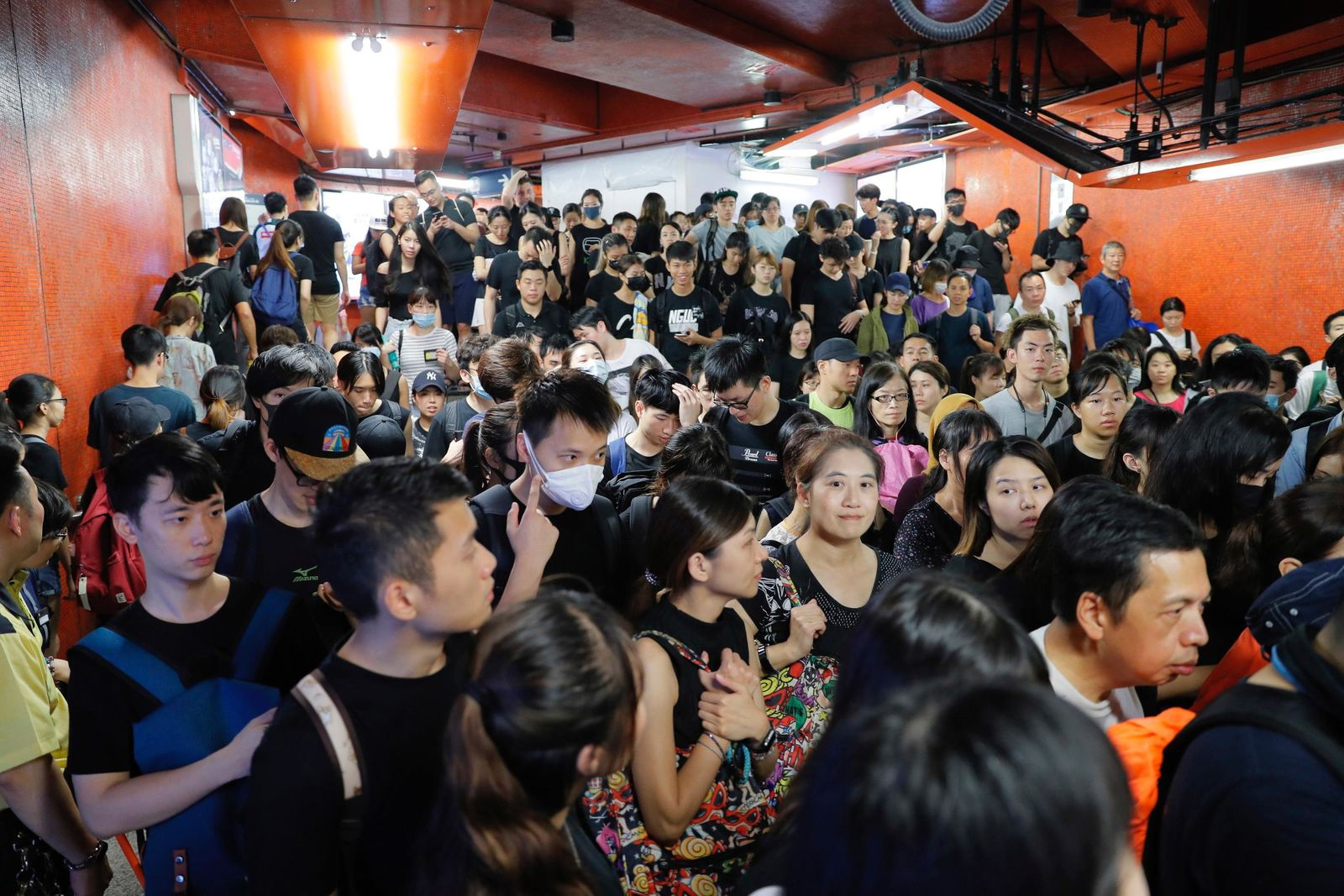 Protesters file into a subway station near Victoria Park in Hong Kong on Sunday, Aug. 18, 2019. (AP Photo/Kin Cheung)