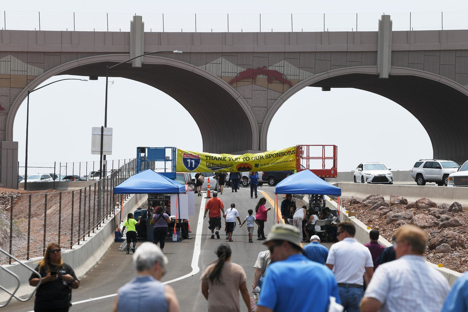 Attendees leave the festivities after the grand opening of a new section of Interstate 11 Thursday, August 9, 2018, in Boulder City. The section, also referred to as the Boulder City Bypass, marks the official start of the I-11 project between Las Vegas and Phoenix. CREDIT: Sam Morris/Las Vegas News Bureau