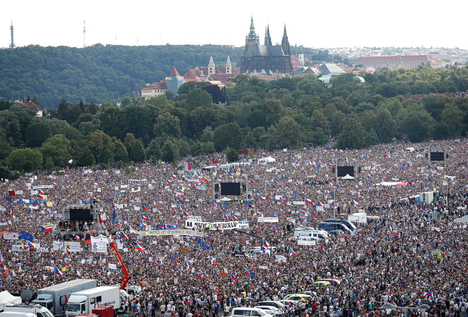 People gather for a protest in Prague, Czech Republic, Sunday, June 23, 2019. Protesters are on calling on Czech Prime Minister Andrej Babis to step down over fraud allegations and subsidies paid to his former companies. (AP Photo/Petr David Josek)