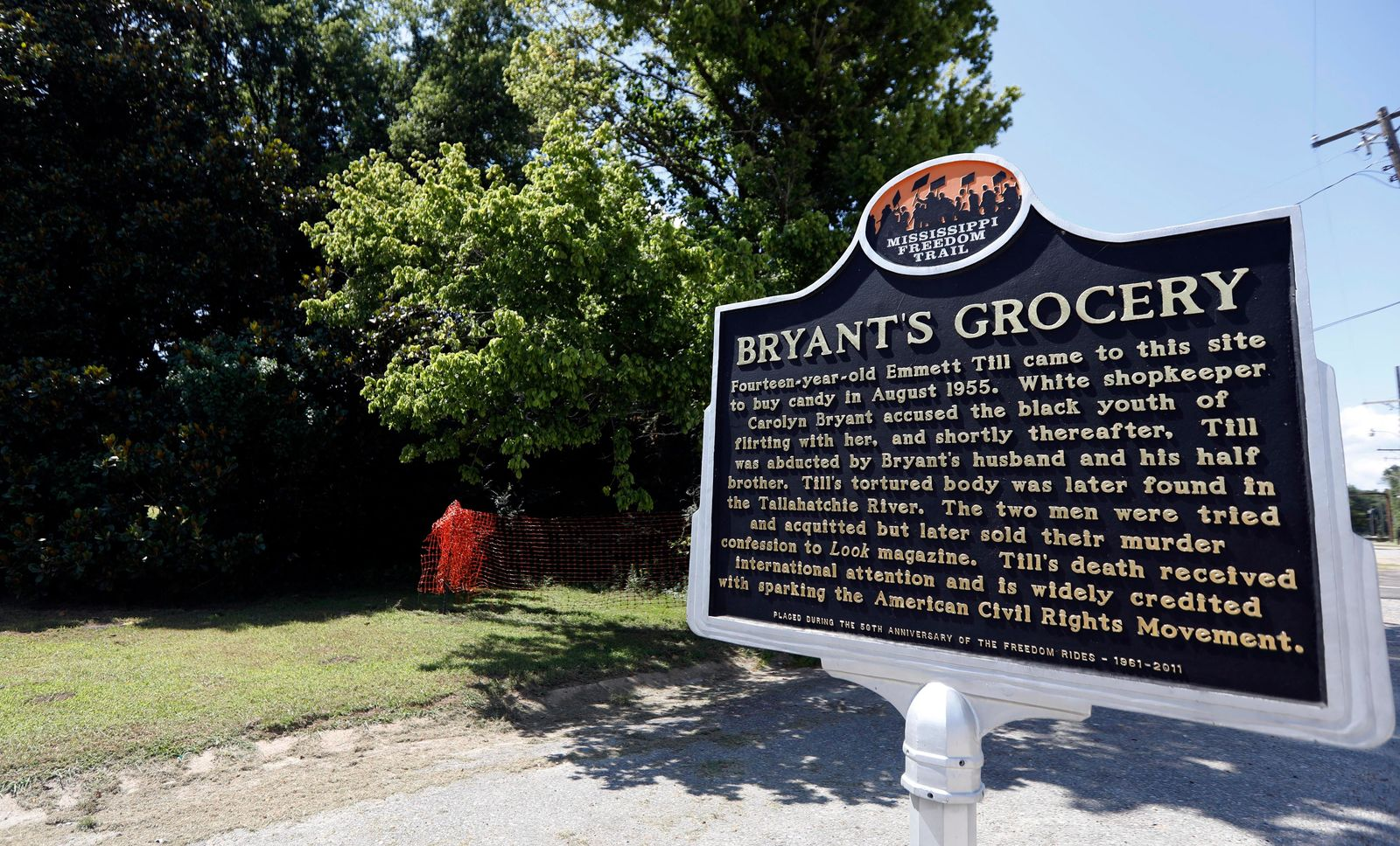 FILE -In this July 12, 2018 file photo, a Mississippi Freedom Trail marker recaps the significance of Bryant's Grocery and Meat Market, left, now in ruins, in Money, Miss., where in 1955, 14-year old Emmett Till, an African American male, allegedly whistled, grabbed and made sexual advances to Carolyn Bryant, a white woman, then wife of the store's owner. The federal government is still investigating the brutal slaying of Till, whose death helped spur the civil rights movement 60 years ago. A Justice Department report issued to Congress about civil rights cold case investigations lists Till's killing as being among the unit's active cases.  (AP Photo/Rogelio V. Solis, File)