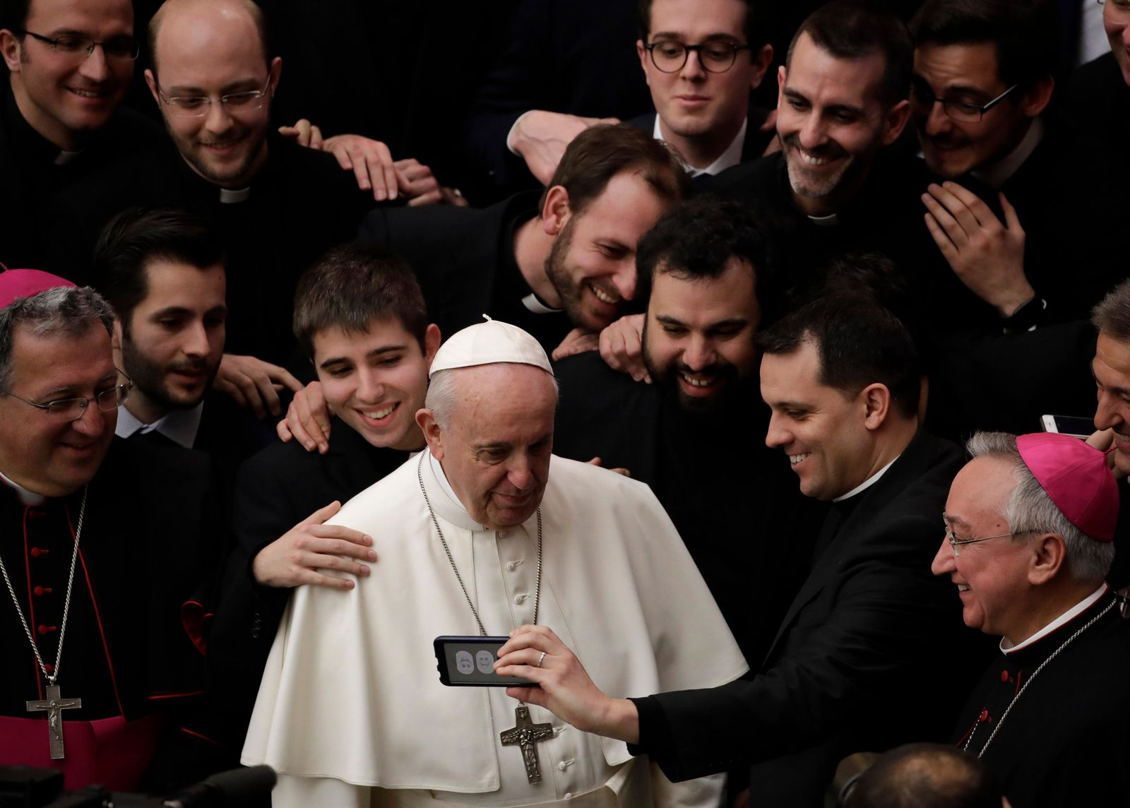 Pope Francis poses for a photo with a group of priests at the end of his weekly general audience in the Paul VI Hall at the Vatican Wednesday, Feb. 20, 2019. (AP Photo/Alessandra Tarantino)