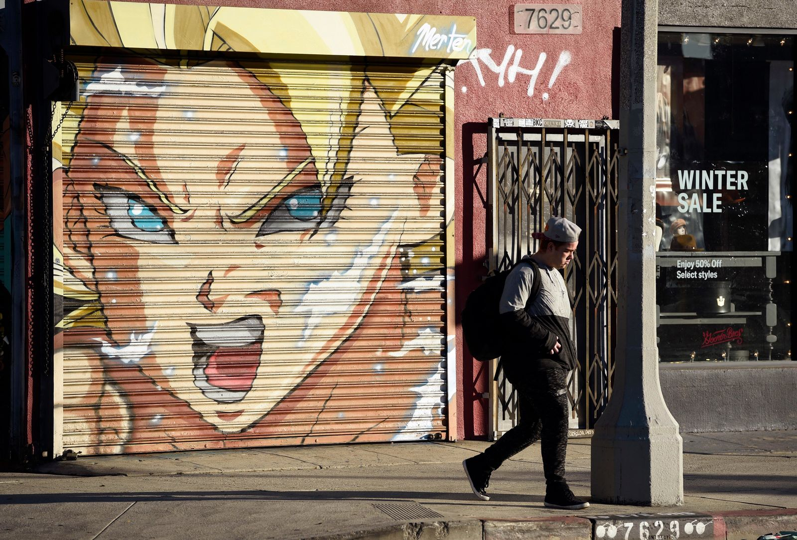 "This Jan. 9, 2019 photo shows a pedestrian walking past a mural depicting ""Caulifla"" by artist Jake Merten inspired by the ""Dragon Ball"" anime series in Los Angeles.{ } (AP Photo/Chris Pizzello)"