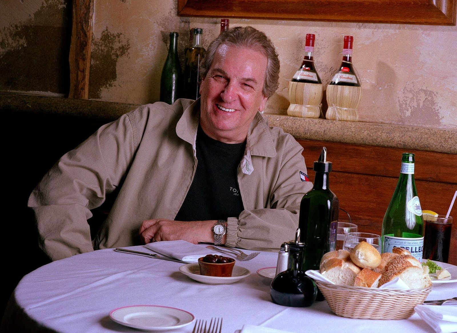 "FILE - In this July 28, 2001 file photo, Danny Aiello poses for a photo at Gigino restaurant in New York. Aiello, the blue-collar character actor whose long career playing tough guys included roles in ""Fort Apache, the Bronx,""  ""The Godfather, Part II,"" ""Once Upon a Time in America"" and his Oscar-nominated performance as a pizza man in Spike Lee's ""Do the Right Thing,"" has died.{ } (AP Photo/Jim Cooper, File)"