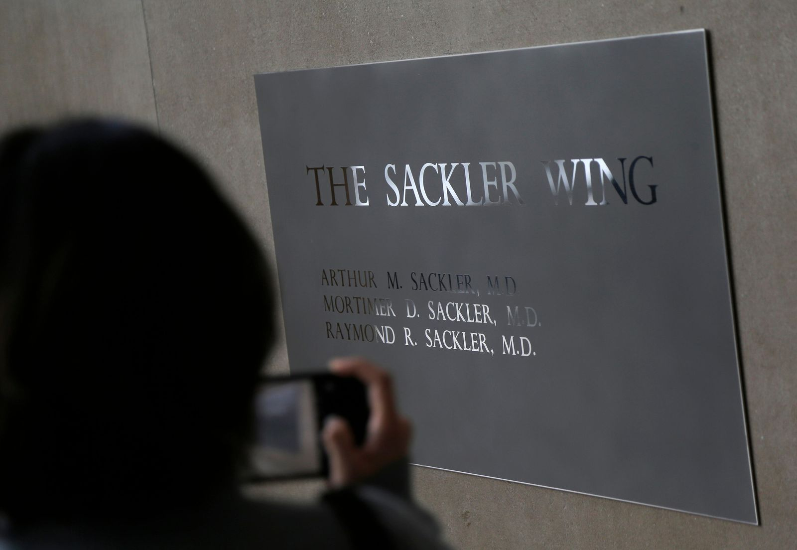 A sign with some names of the Sackler family is displayed at the Metropolitan Museum of Art in New York, Thursday, Jan. 17, 2019. (AP Photo/Seth Wenig)