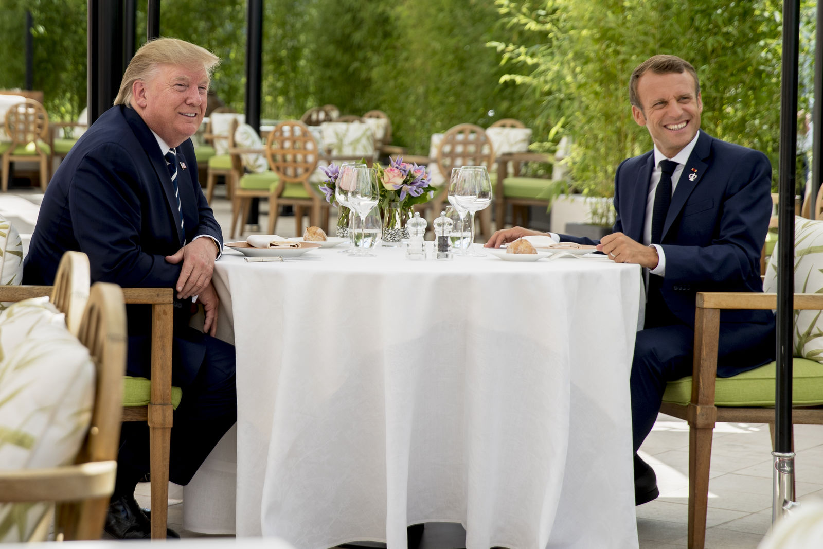 U.S President Donald Trump sits for lunch with French President Emmanuel Macron, right, at the Hotel du Palais in Biarritz, south-west France, Saturday Aug. 24, 2019.{ } (AP Photo/Andrew Harnik)