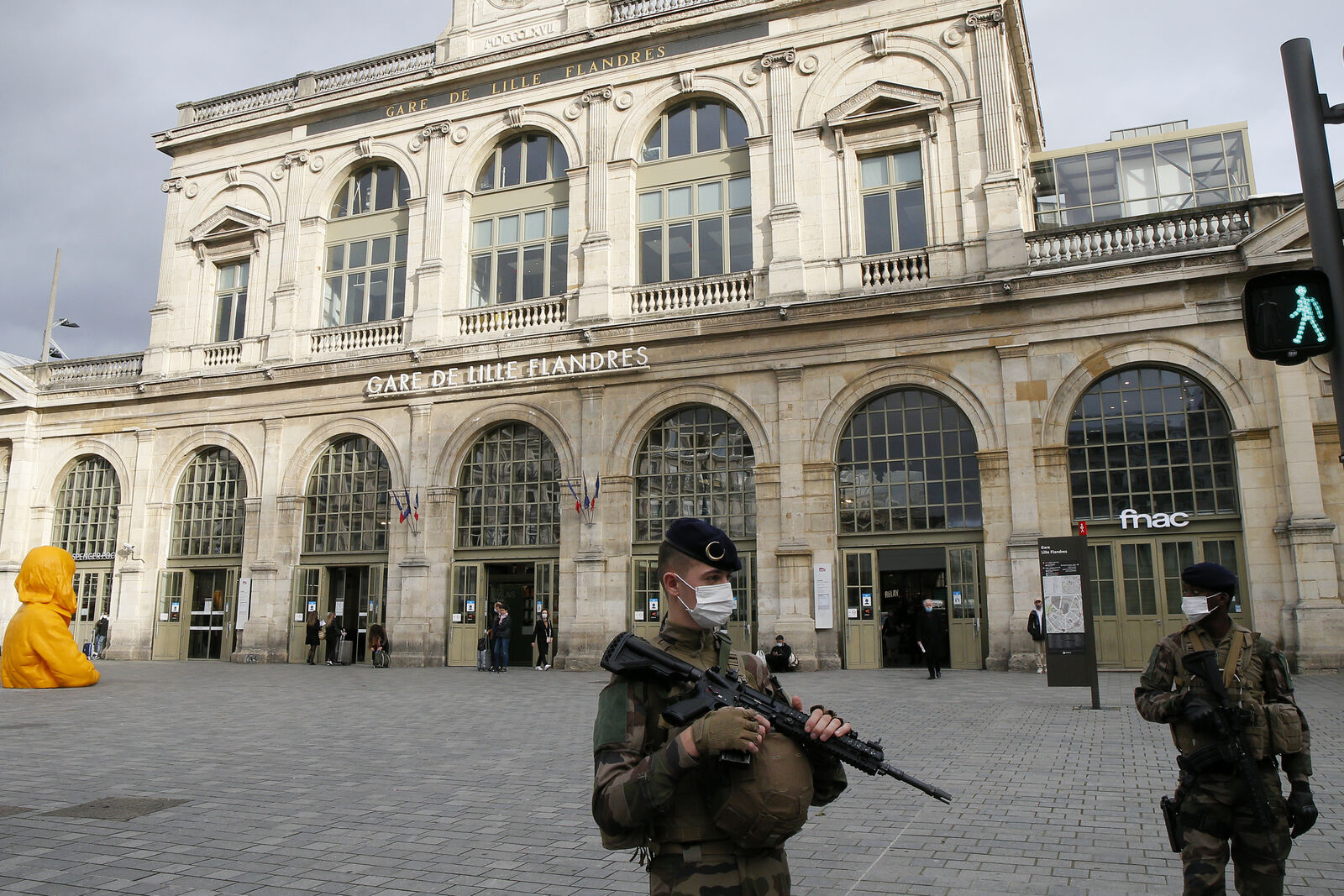 French soldiers patrol next to the station in Lille northern France, Friday, Oct. 30, 2020.{ } (AP Photo/Michel Spingler)
