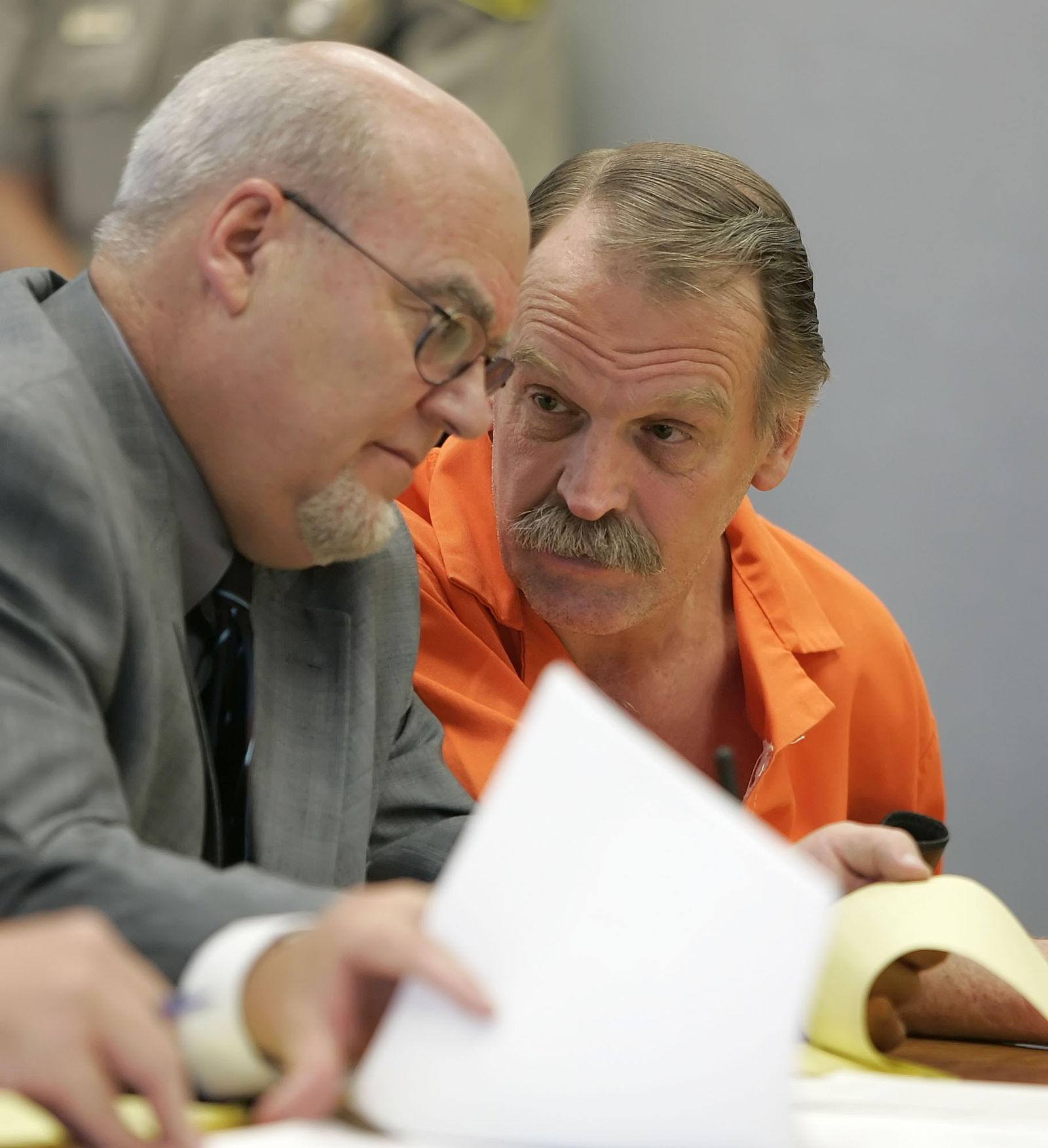 "FILE - In this Oct. 6, 2005, file photo, Ron Lafferty, right, confers with his attorney Bill Morrison at his court hearing in the 4th District Courtroom of Judge Anthony Schofield in Provo, Utah. Utah prison officials said Monday, Nov. 11, 2019, that Lafferty, a death-row inmate whose double-murder case was featured in the book ""Under the Banner of Heaven"" and who was nearing an execution by firing squad, has died of natural causes. (AP Photo/George Frey, File)"