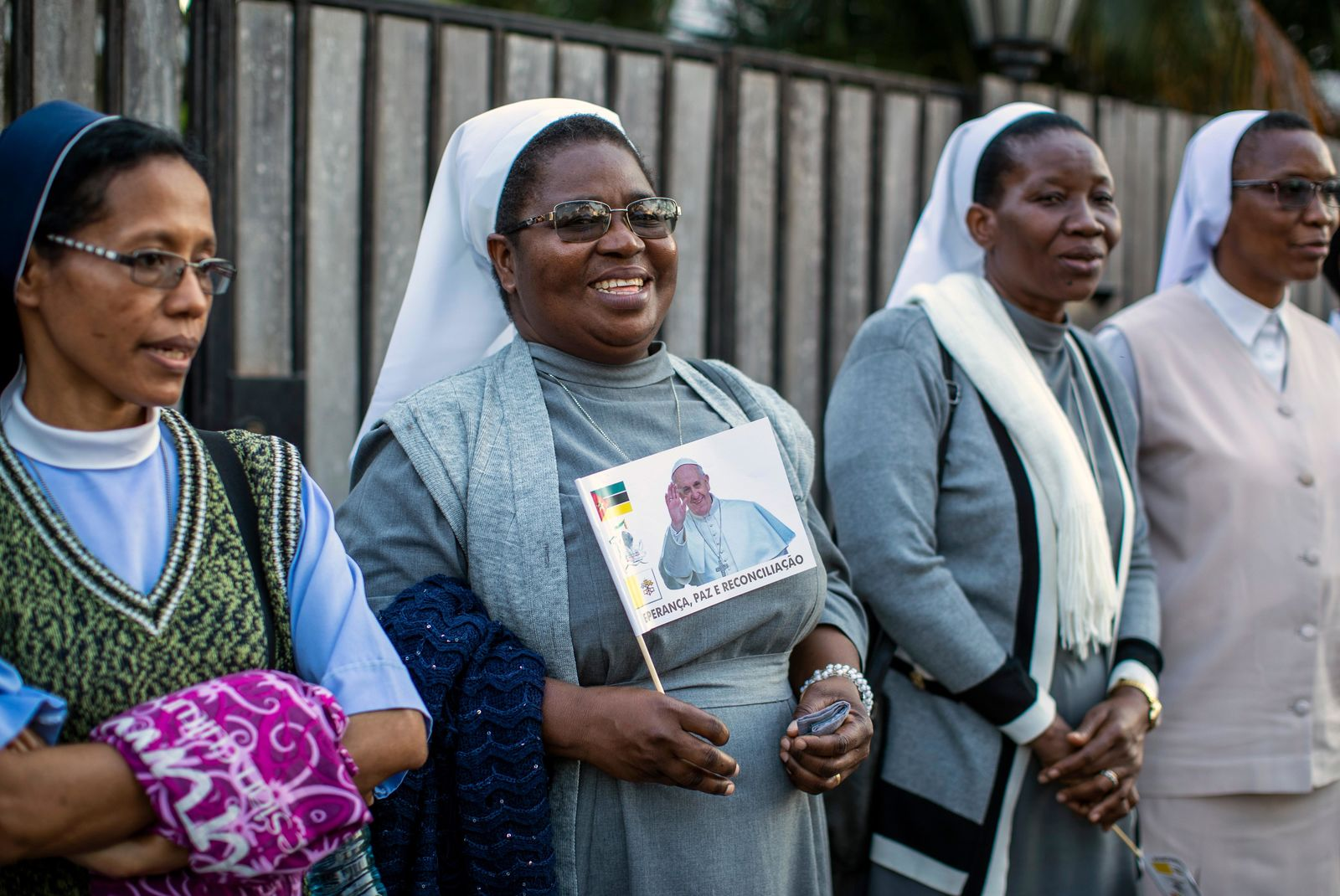 Nuns wait to see Pope Francis, ahead of his expected arrival near to the Apostolic Nunciature in the capital Maputo, Mozambique Wednesday, Sept. 4, 2019. Pope Francis is opening a three-nation pilgrimage to southern Africa with a strategic visit to Mozambique, just weeks after the country's ruling party and armed opposition signed a new peace deal and weeks before national elections. (AP Photo/Ben Curtis)