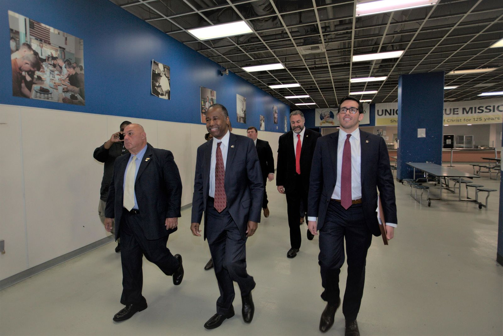 U.S. Department of Housing and Urban Development secretary Ben Carson, second from left, tours the Union Rescue Mission in Skid Row area of downtown Los Angeles Wednesday, Sept. 18, 2019. (AP Photo/Damian Dovarganes)