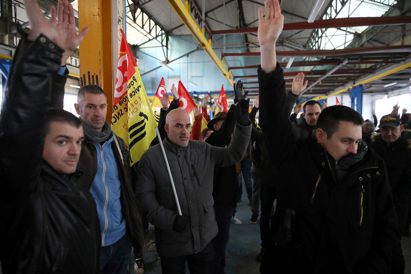 Railway workers votes during a meeting of the CGT union in Rennes, western France, Monday, Dec. 9, 2019. (AP Photo/David Vincent)