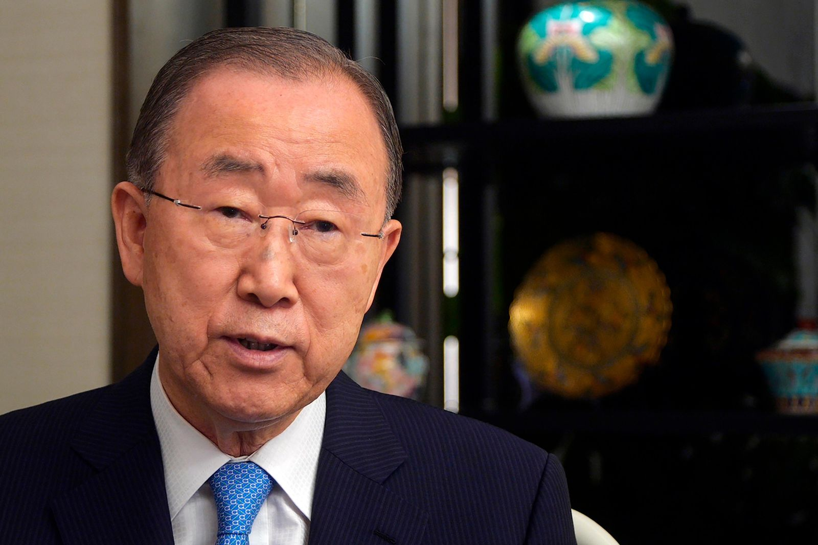CORRECTS DATE - In this Monday, Sept. 9, 2019, photo, former U.N. Secretary-General Ban Ki-moon speaks during an interview on the sidelines of a press conference for the release of a report on adapting to climate change in Beijing. (AP Photo/Sam McNeil)