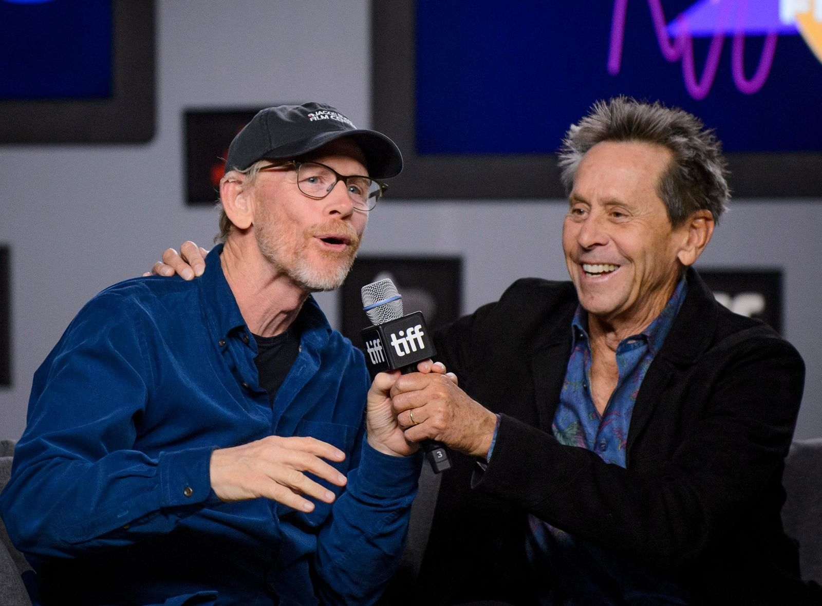"Executive Producers Ron Howard, left, and Brian Grazer attend a press conference to promote the movie ""Once Were Brothers: Robbie Robertson and The Band"" during the 2019 Toronto International Film Festival in Toronto on Thursday, Sept. 5, 2019. (Andrew Lahodynskyj/The Canadian Press via AP)"