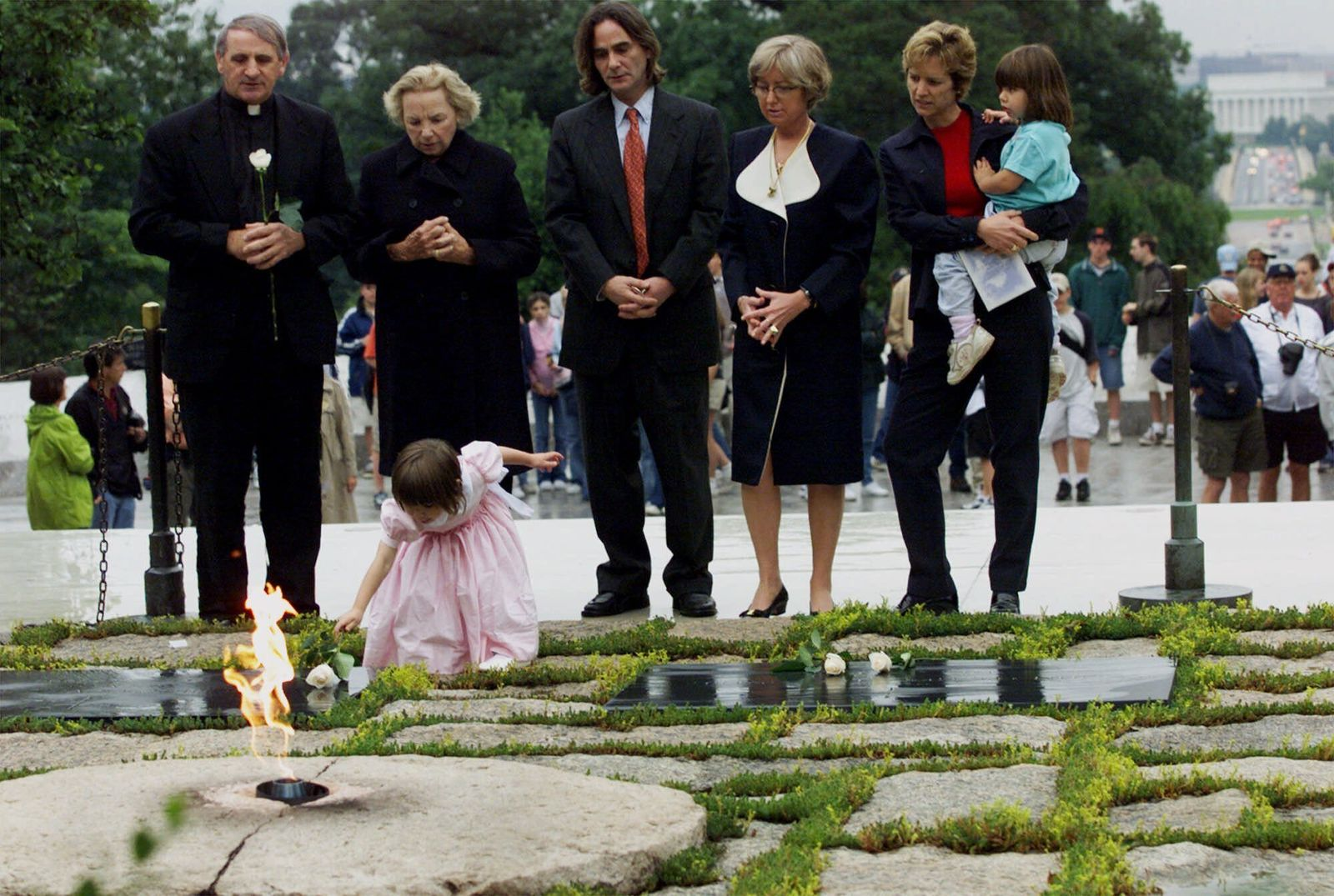 FILE - In this June 6, 2000 file photo, Robert F. Kennedy's granddaughter Saoirse Kennedy Hill places a white rose at the Eternal Flame, President John F. Kennedy's gravesite, at Arlington National Cemetery in Arlington, Va. Hill, has died at the age of 22.{ } (AP Photo/Hillery Smith Garrison, File)
