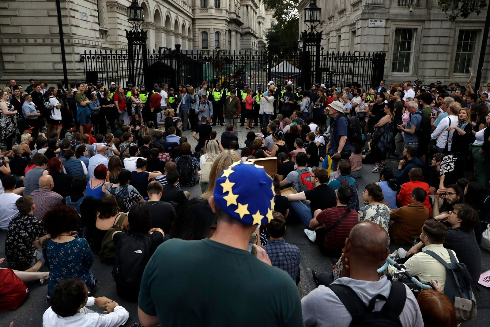 Anti-Brexit supporters gather outside the Prime Minister's residence 10 Downing Street in London, Wednesday, Aug. 28, 2019. (AP Photo/Matt Dunham)
