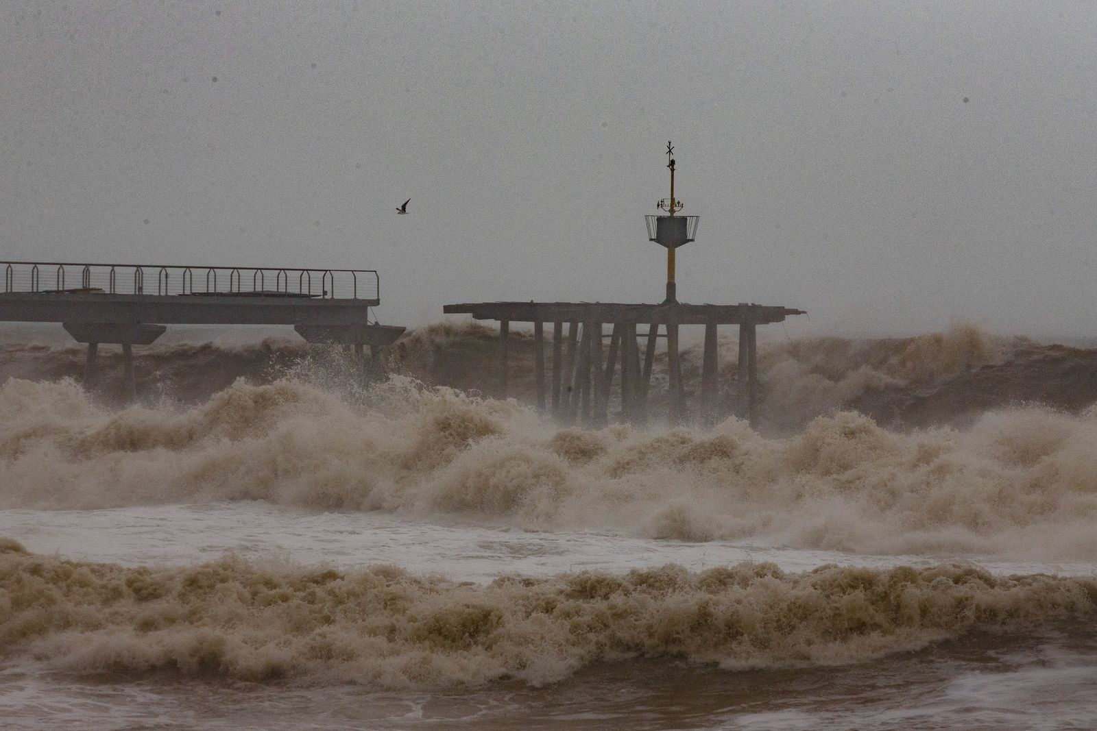 Waves hit a partially damage bridge during a storm in Badalona's beach, outskirts of Barcelona, Spain, Wednesday, Jan. 22, 2020. (AP Photo/Joan Mateu)