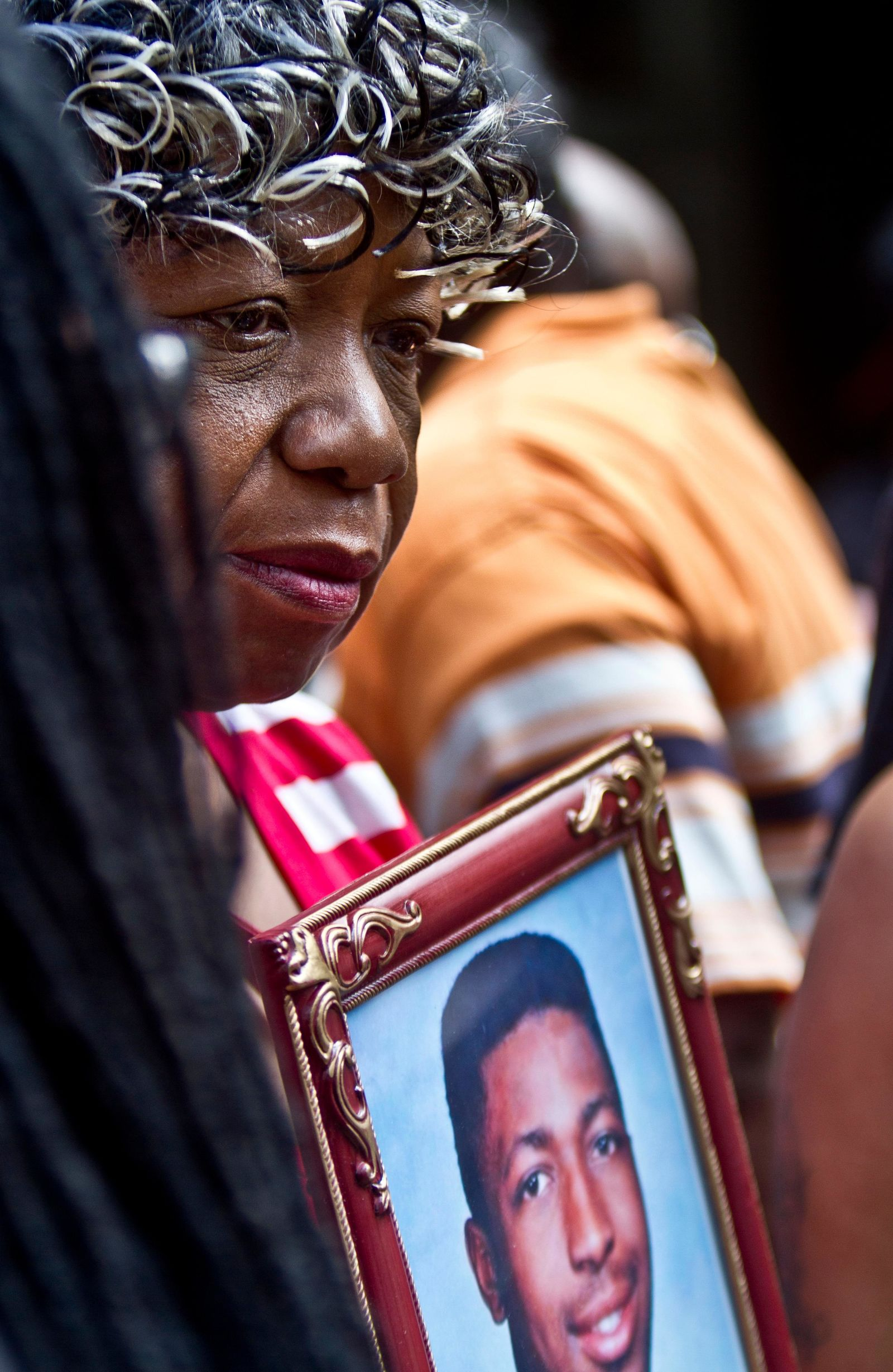 FILE - In this July 7, 2015, file photo, Gwen Carr holds a picture of her son Eric Garner during a news conference in New York with relatives of other New Yorkers killed by police. (AP Photo/Bebeto Matthews, File)