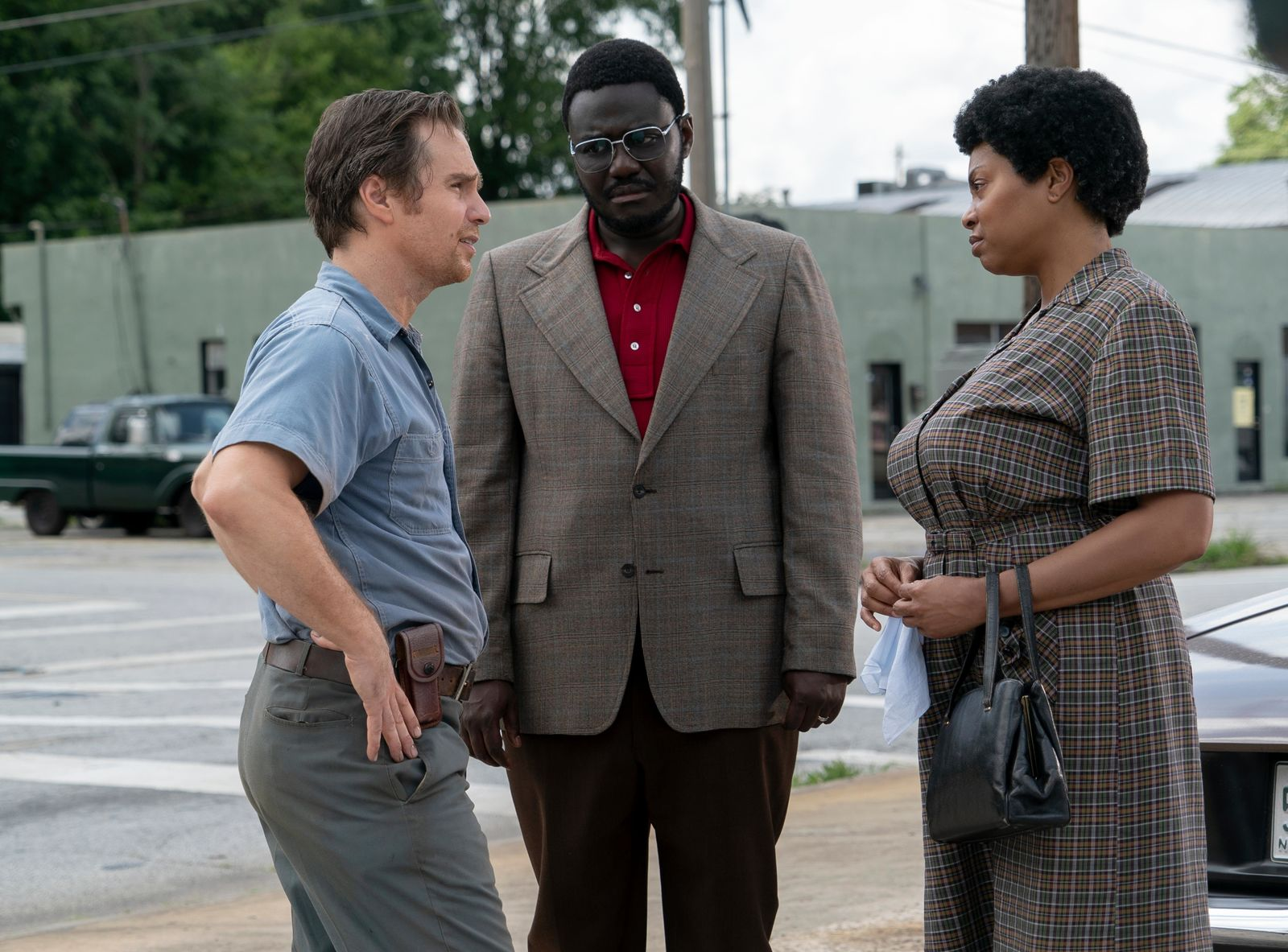 (L-R) Sam Rockwell, Babou Ceesay and Taraji P. Henson star in THE BEST OF ENEMIES (Photo: STX Entertainment)