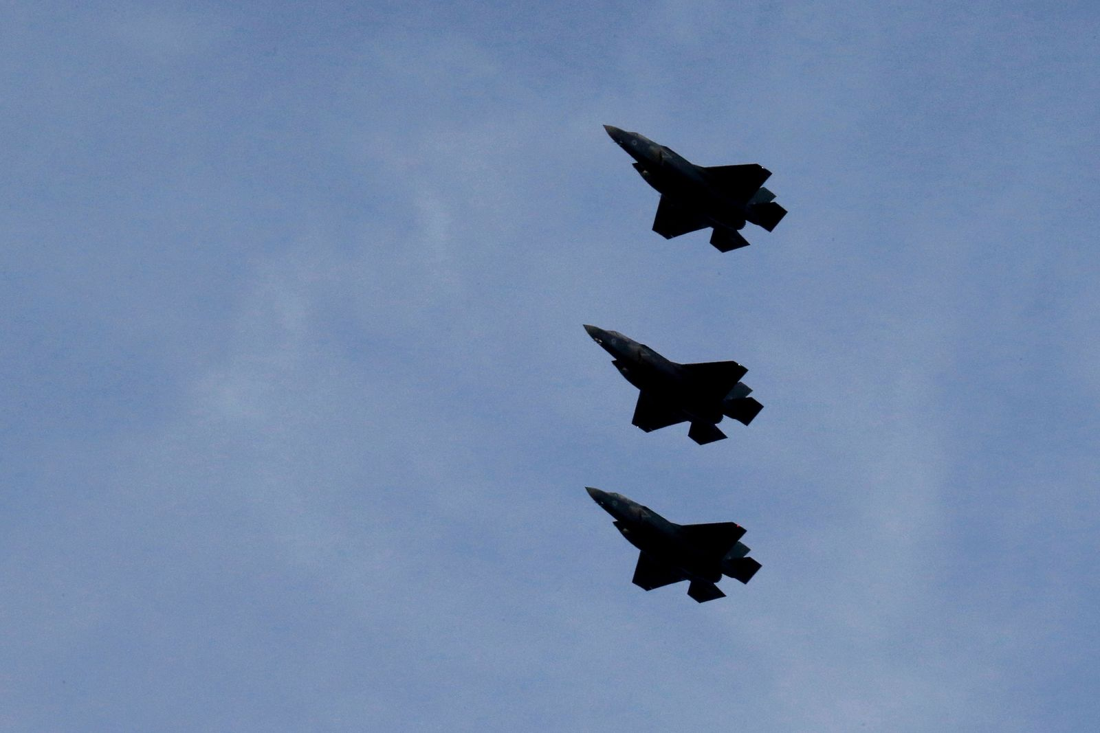 FILE - In this Tuesday, May 21, 2019 file photo, F-35B aircrafts fly over the Akrotiri Royal air forces base before landing, near city of Limassol, Cyprus. Britain's defense secretary said the country's most advanced military aircraft, the Lightning F-35B, that is undergoing training at a British air base in Cyprus has flown its first missions over Syria and Iraq as part of the ongoing operations against the Islamic State group, in a statement issued Tuesday June 25, 2019. (AP Photo/Petros Karadjias, File)