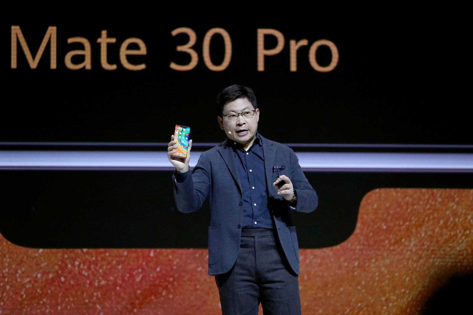 Richard Yu, CEO of the Huawei consumer business group, presents the new 'Mate 30 Pro' smartphone during an event in Munich, Germany, Thursday, Sept. 19, 2019. (AP Photo/Matthias Schrader)