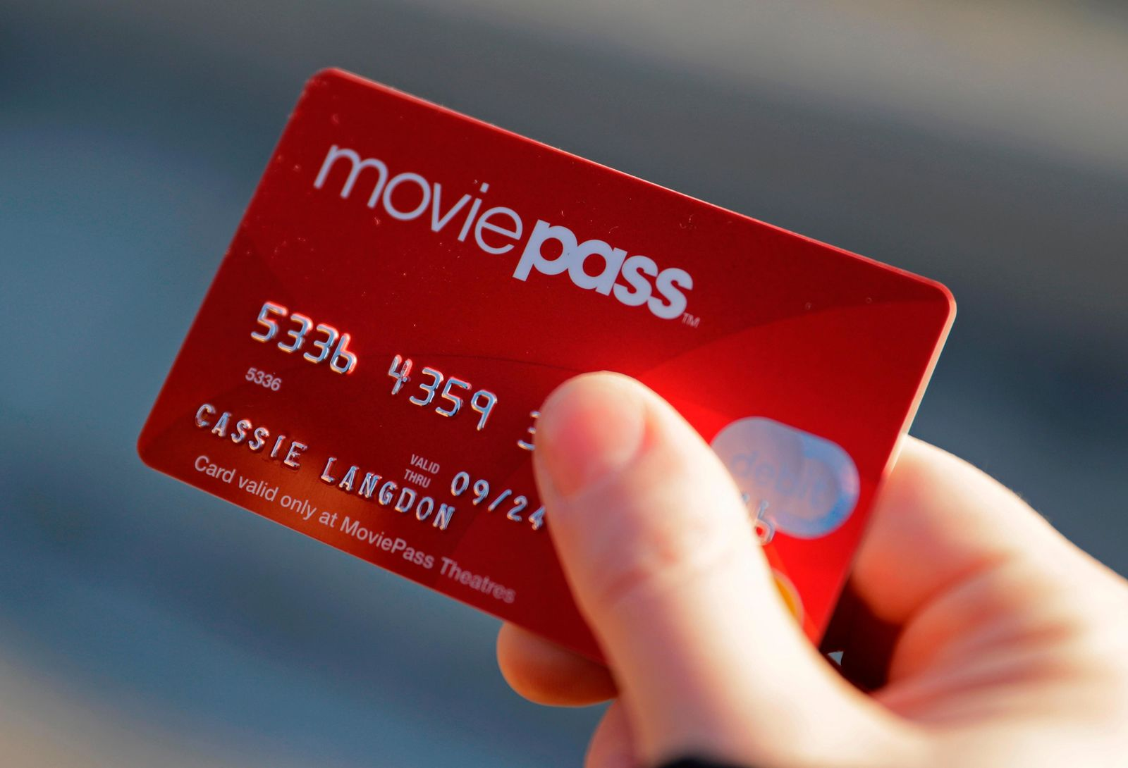 FILE - In this Jan. 30, 2018 file photo, Cassie Langdon holds her MoviePass card outside AMC Indianapolis 17 theatre in Indianapolis.{ } (AP Photo/Darron Cummings, File)