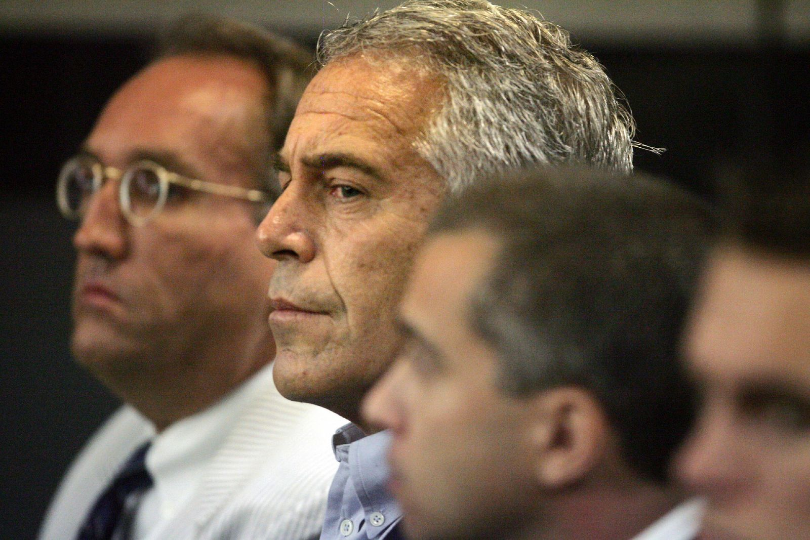 FILE - In this July 30, 2008, file photo, Jeffrey Epstein, center, appears in court in West Palm Beach, Fla. (Uma Sanghvi/Palm Beach Post via AP, File)