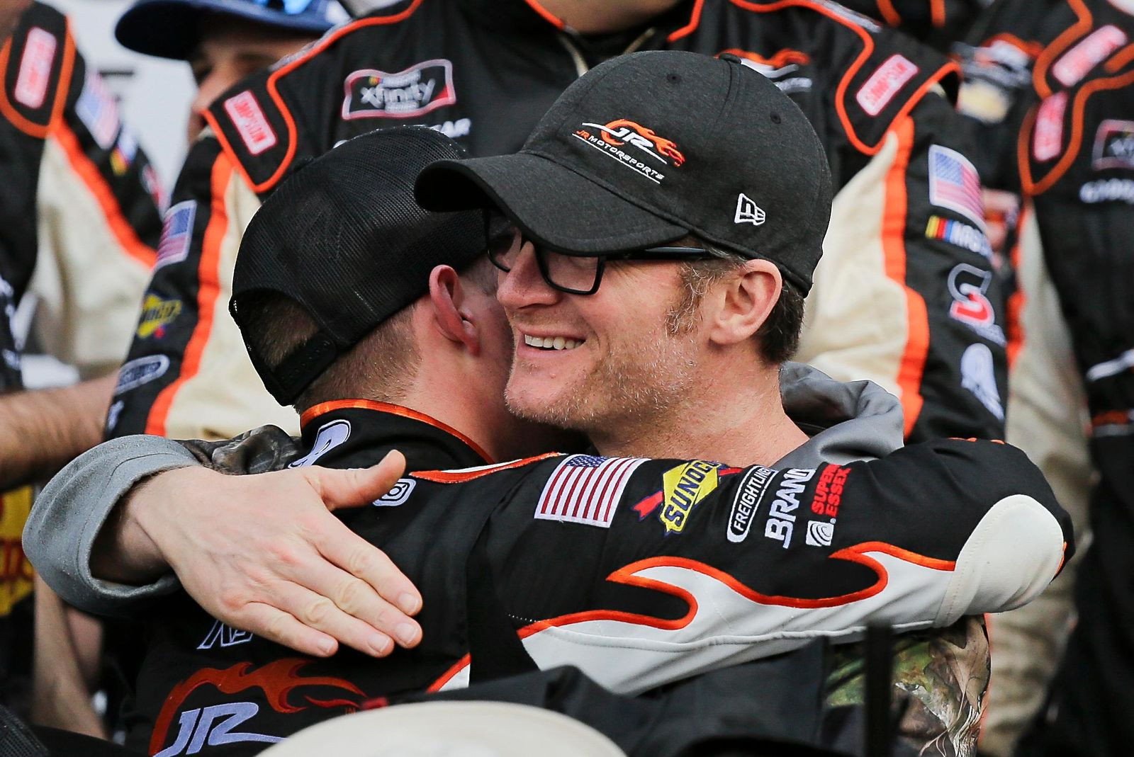 Car owner Dale Earnhardt Jr., right, hugs driver Noah Gragson in Victory Lane after he won the NASCAR Xfinity series auto race at Daytona International Speedway, Saturday, Feb. 15, 2020, in Daytona Beach, Fla. (AP Photo/Terry Renna)