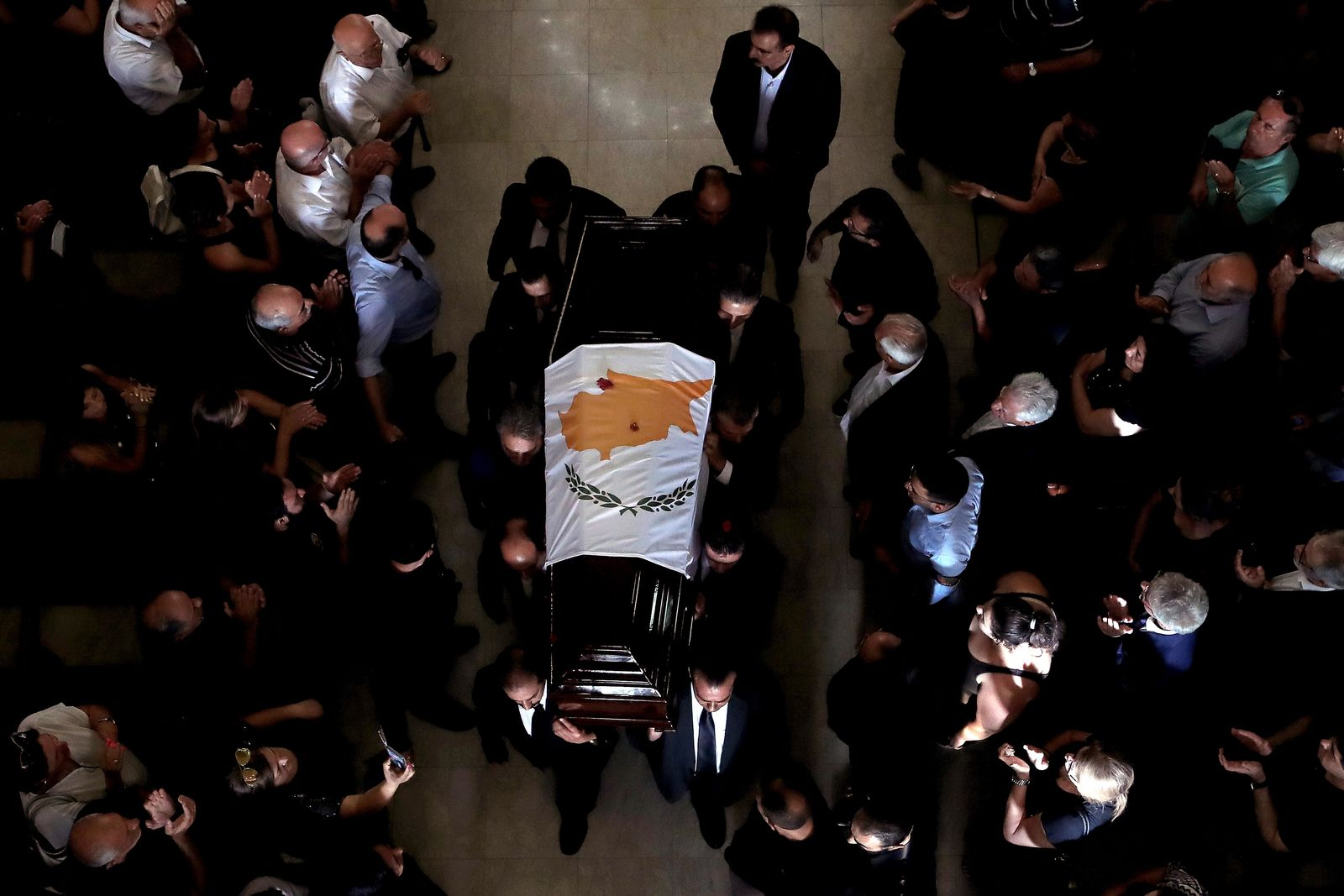 Pallbearers carry the coffin of the former Cyprus' President Dimitris Christofias during his state funeral at the Orthodox Christian Church of the Lord's Wisdom in capital Nicosia, Cyprus, Tuesday, June 25, 2019.{ } (AP Photo/Petros Karadjias)