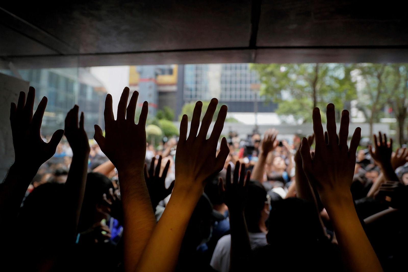 Protesters gesture inside the Hong Kong Revenue Tower as they block the building lobby to prevent people from entering in Hong Kong, Monday, June 24, 2019.{ } (AP Photo/Kin Cheung)