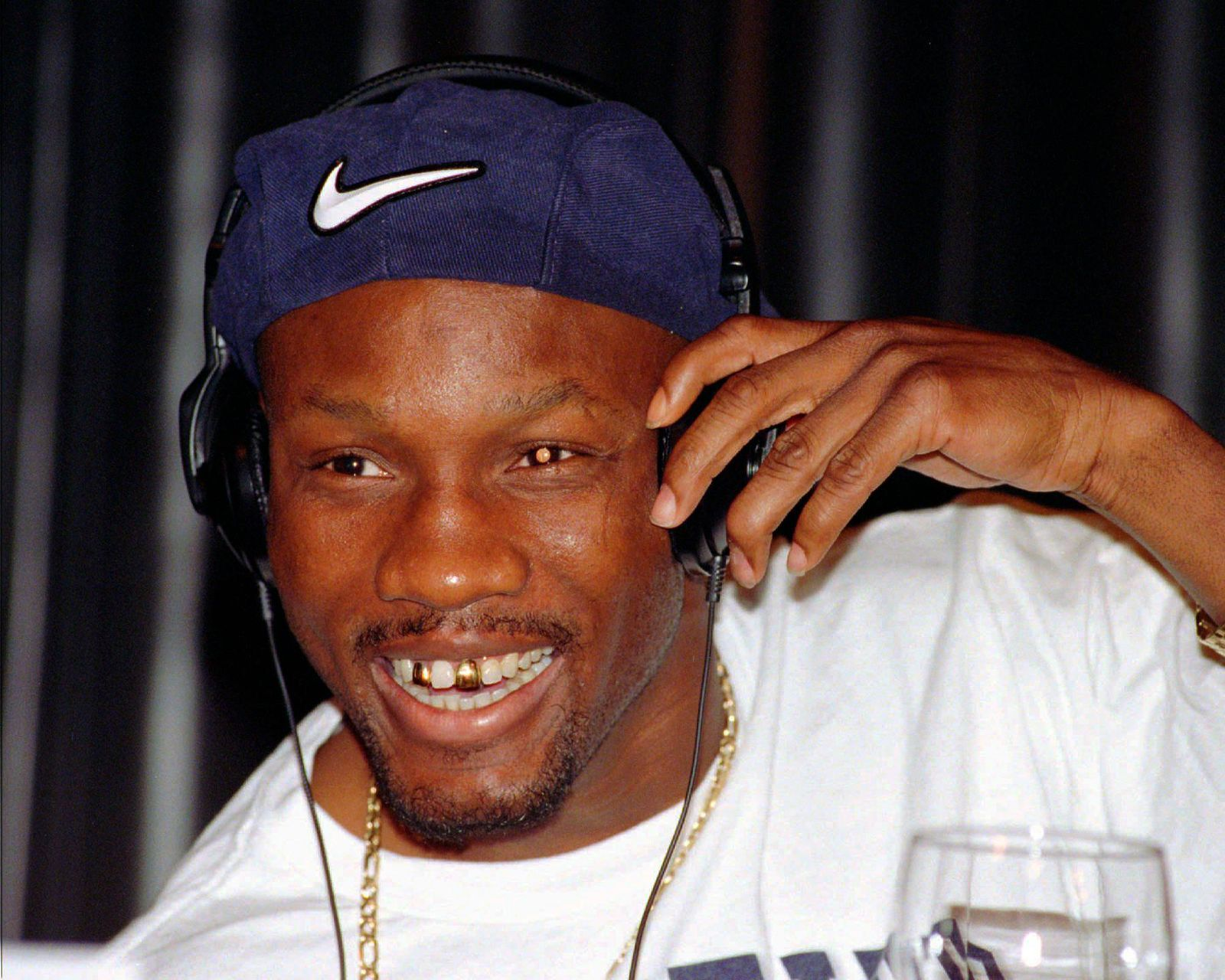 FILE - In this April 9, 1997, file photo, WBC welterweight champion Pernell Whitaker adjusts his head phones during a news conference in Las Vegas. Former boxing champion Pernell Whitaker has died after he was hit by a car in Virginia. He was 55. Police in Virginia Beach on Monday say Whitaker was a pedestrian when struck by the car Sunday night, July 14, 2019. The driver remained on the scene, where Whitaker was pronounced dead. (AP Photo/Lennox McLendon, File)