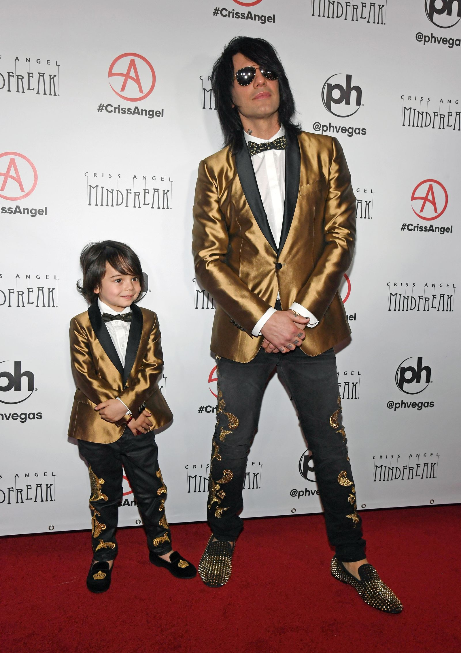 "LAS VEGAS, NEVADA - JANUARY 19:  Johnny Crisstopher Sarantakos and illusionist Criss Angel attend the grand opening of ""Criss Angel MINDFREAK"" at Planet Hollywood Resort & Casino on January 19, 2019 in Las Vegas, Nevada.  (Photo by Ethan Miller/Getty Images for Planet Hollywood Resort & Casino)"