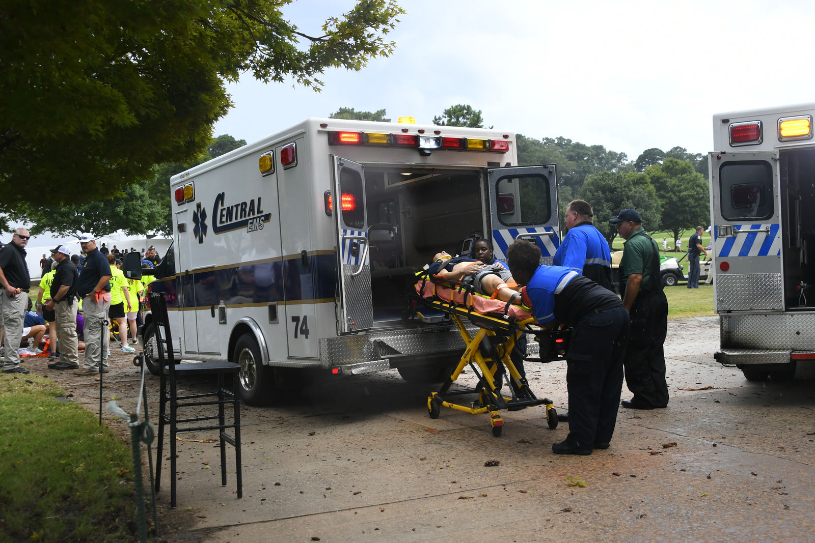 A spectator is taken to an ambulance after a lightning strike on the course which left several injured during a weather delay in the third round of the Tour Championship golf tournament Saturday, Aug. 24, 2019, in Atlanta. (AP Photo/John Amis)