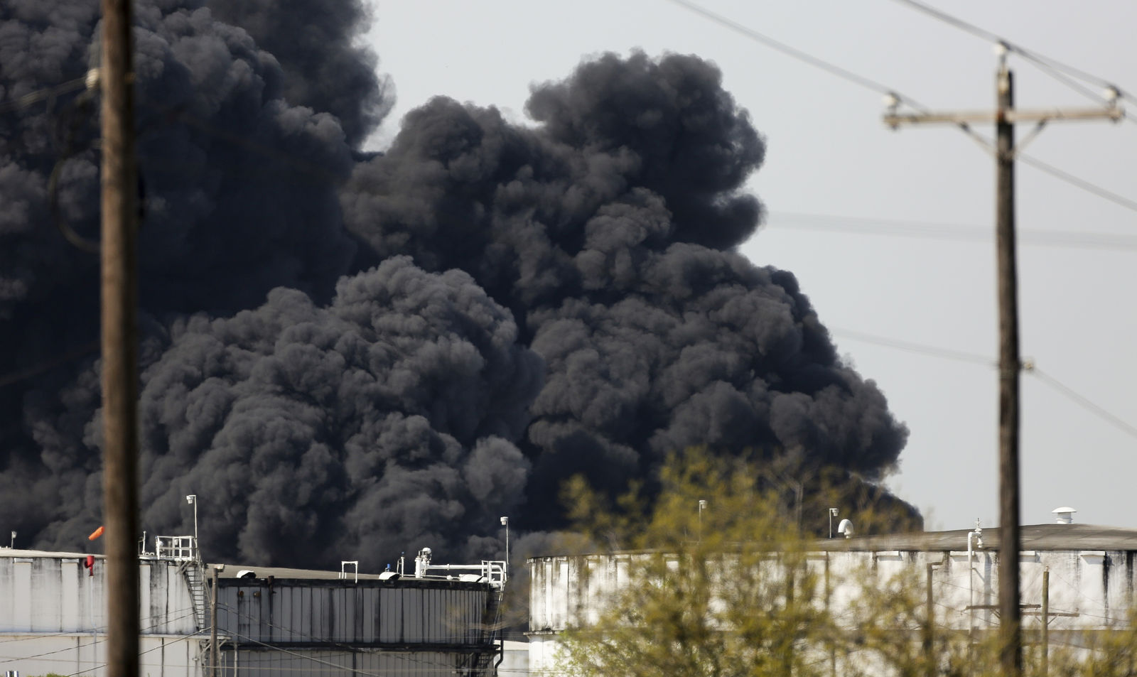 The petrochemical fire at Intercontinental Terminals Company reignited as crews tried to clean out the chemicals that remained in the tanks, Friday, March 22, 2019, in Deer Park, Texas.  The efforts to clean up a Texas industrial plant that burned for several days this week were hamstrung Friday by a briefly reignited fire and a breach that led to chemicals spilling into the nearby Houston Ship Channel. (Godofredo A. Vasquez/Houston Chronicle via AP)
