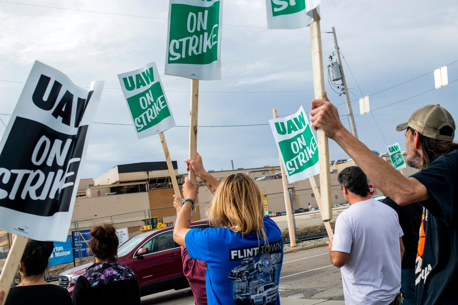 General Motors employees demonstrate outside the Flint Assembly Plant on Sunday, Sept. 15, 2019, in Flint, Mich. The United Auto Workers union says its contract negotiations with GM have broken down and its members will go on strike just before midnight on Sunday.  (Jake May/The Flint Journal via AP)