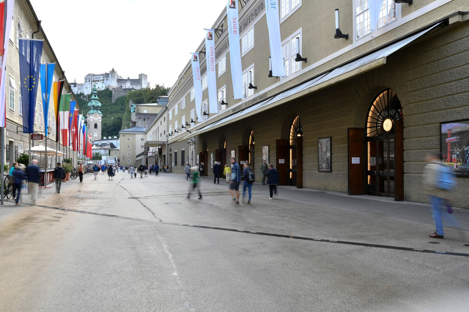 Out side view of the opera house , right, in Salzburg, Austria, Wednesday, Aug. 14, 2019 where singer Placido Domingo will perfom 'Luisa Miller' by Giuseppe Verdi. (AP Photo/Kerstin Joensson)